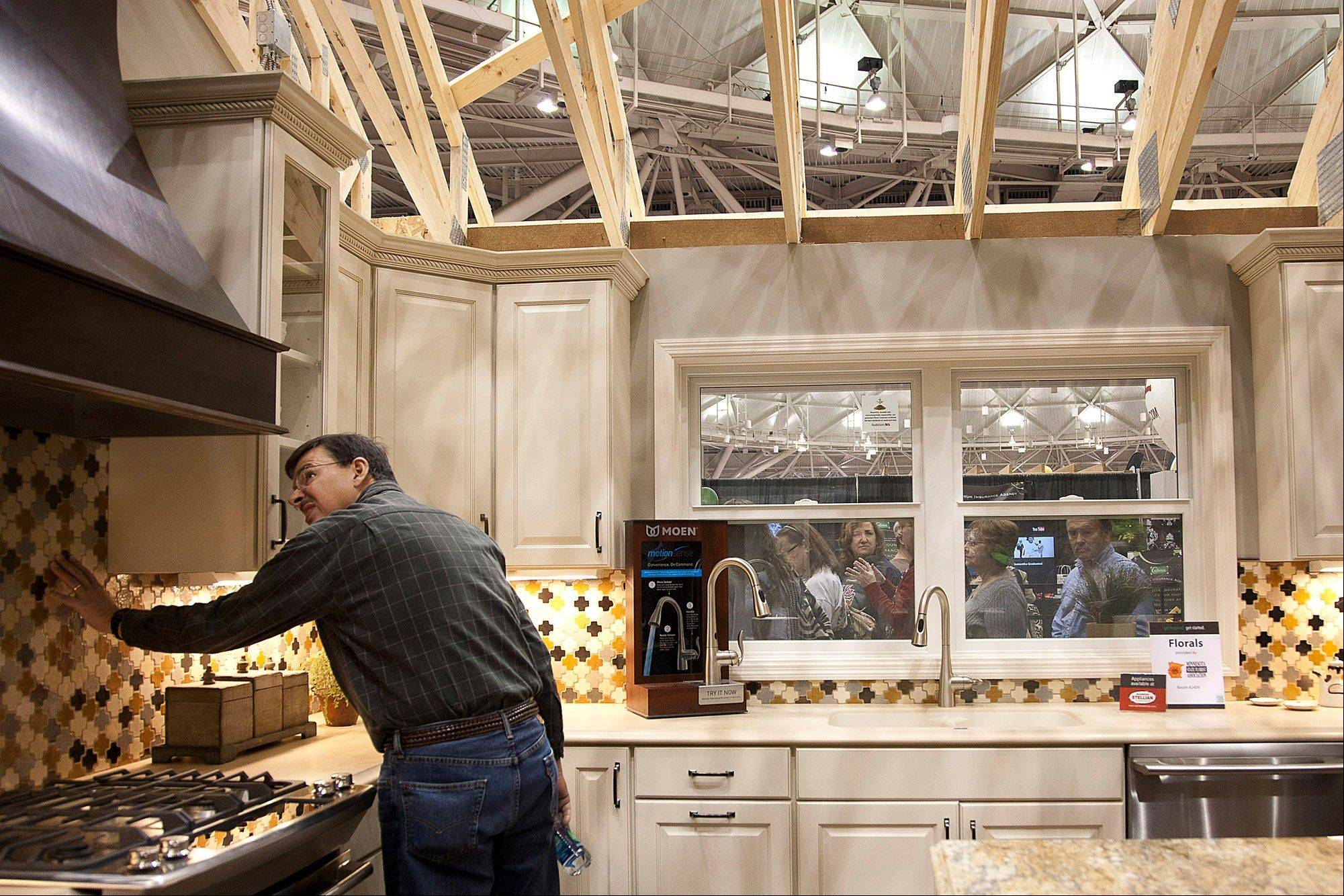 "A man views the kitchen of a 1,700-square-foot ""empty nester"" layout called the Idea Home at the Minneapolis Home & Garden Show in Minneapolis."