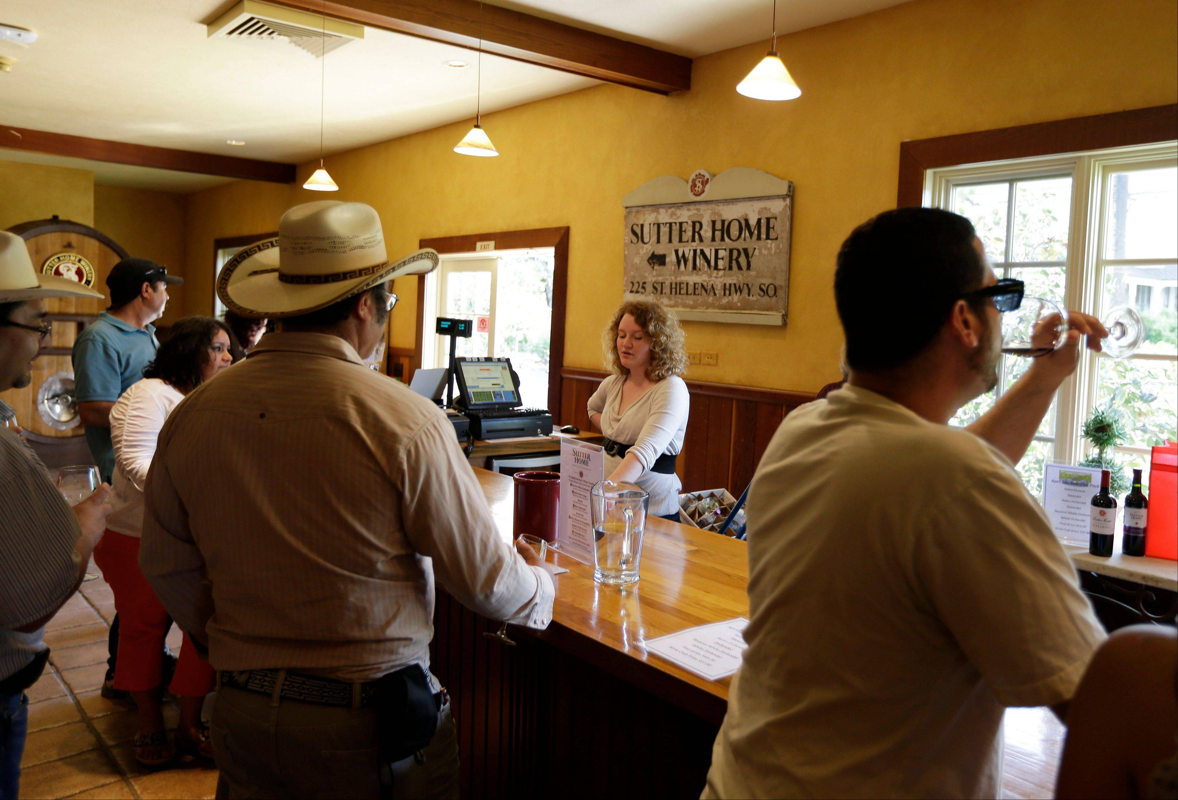 People can try up to four free tastes of wine at Sutter Home Winery in St. Helena, Calif.