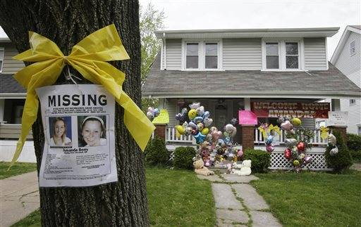 A missing poster still rests on a tree outside the home of Amanda Berry, in Cleveland. For Berry, Gina DeJesus and Michelle Knight, who were freed from captivity inside a Cleveland house earlier this week, the ordeal is not over. Next comes recovery _ from sexual abuse and their sudden, jarring reentry into a world much different than the one they were snatched from a decade ago.
