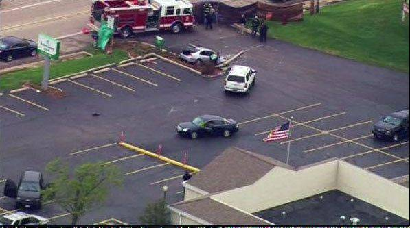 FBI agents exchanged gunfire with the suspects about 11:30 a.m. outside the Associated Bank branch at 10910 N. Main St. in Richmond.