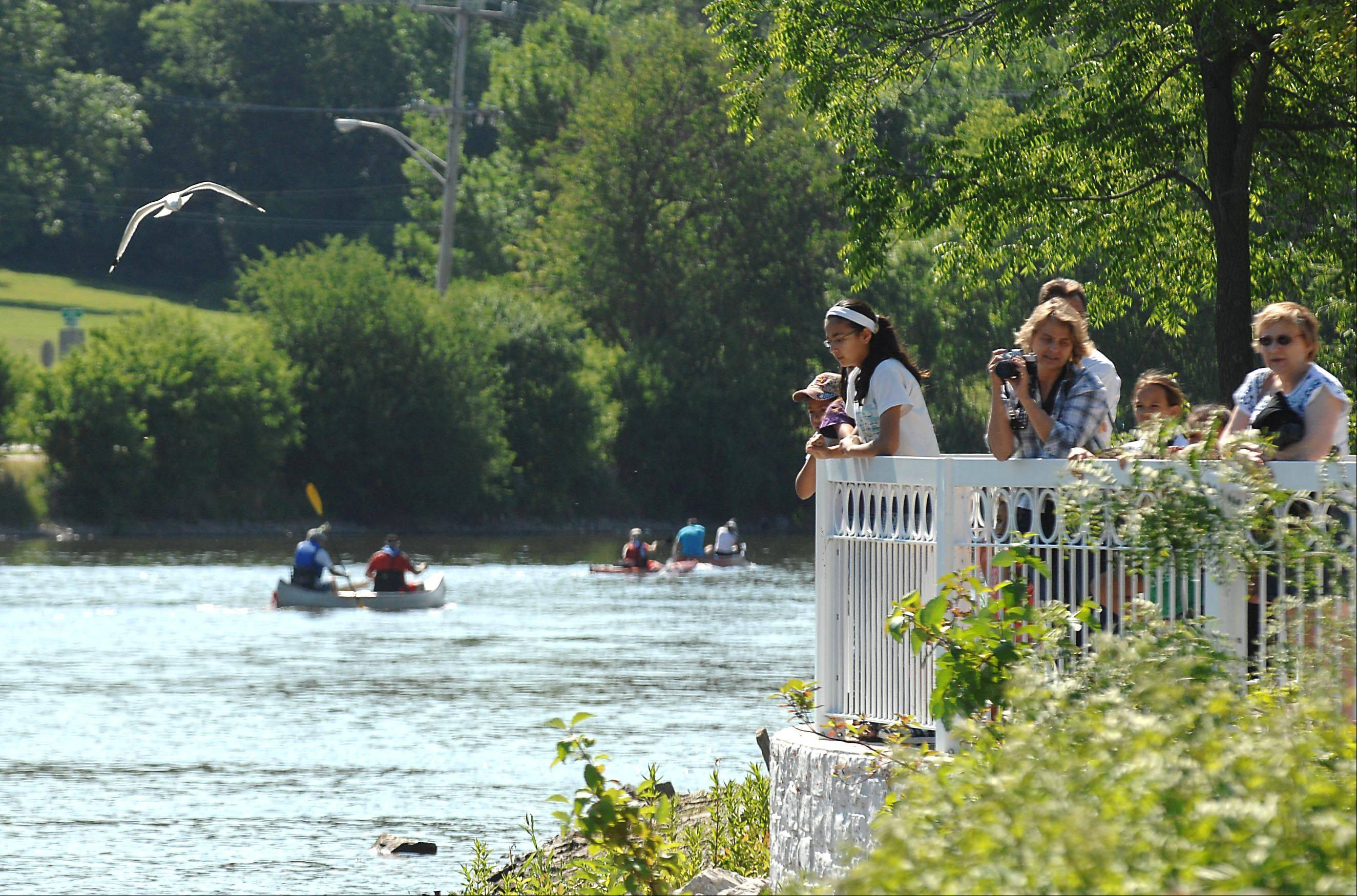 Spectators watch from a deck over the Fox River as the Mid-American Canoe and Kayak Race. Organizers are hoping 500 canoes will participate in this year's race.