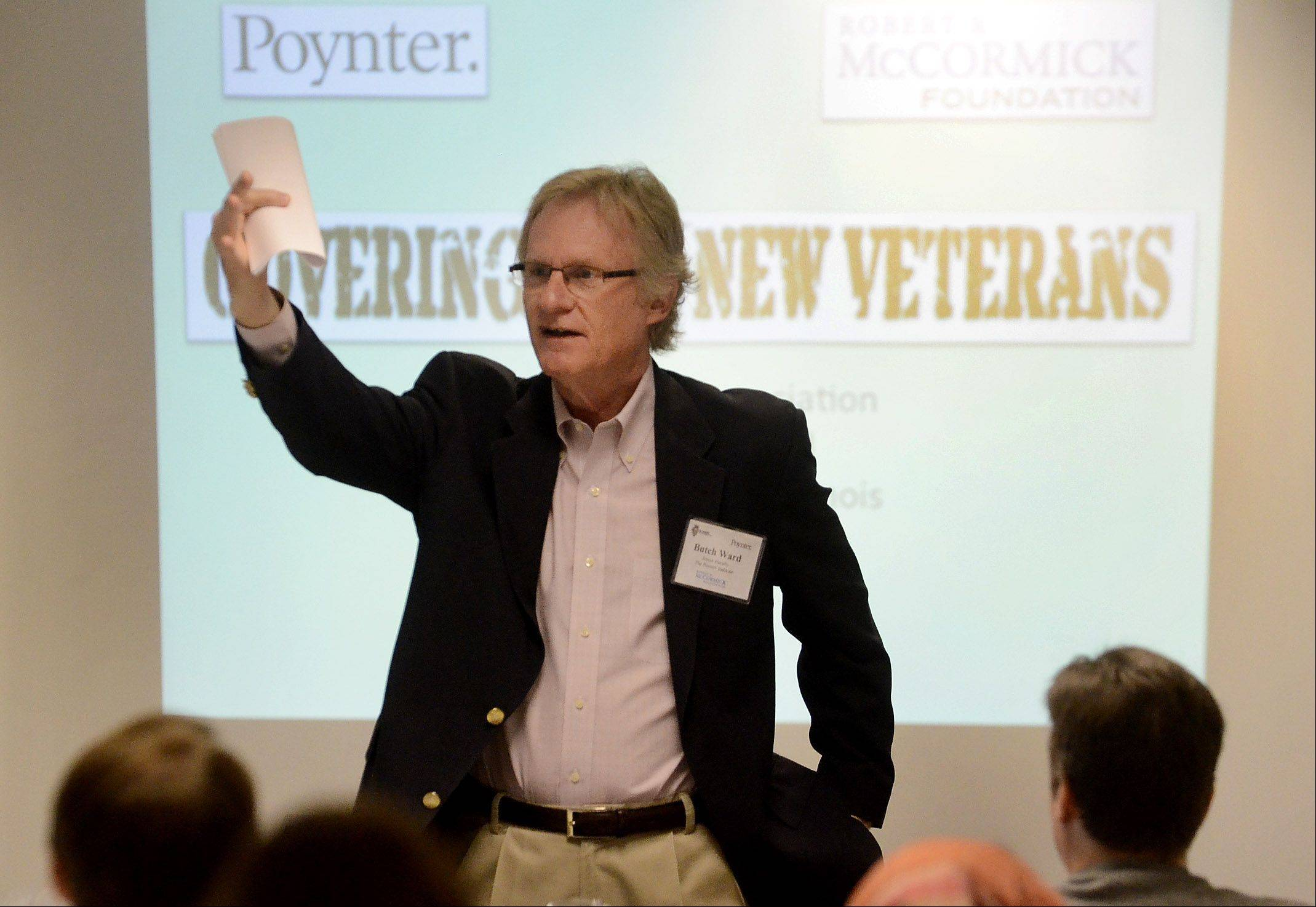 "Butch Ward, a senior faculty member at The Poynter Institute, moderates the Illinois Press Association seminar on ""Covering the New Veterans."""
