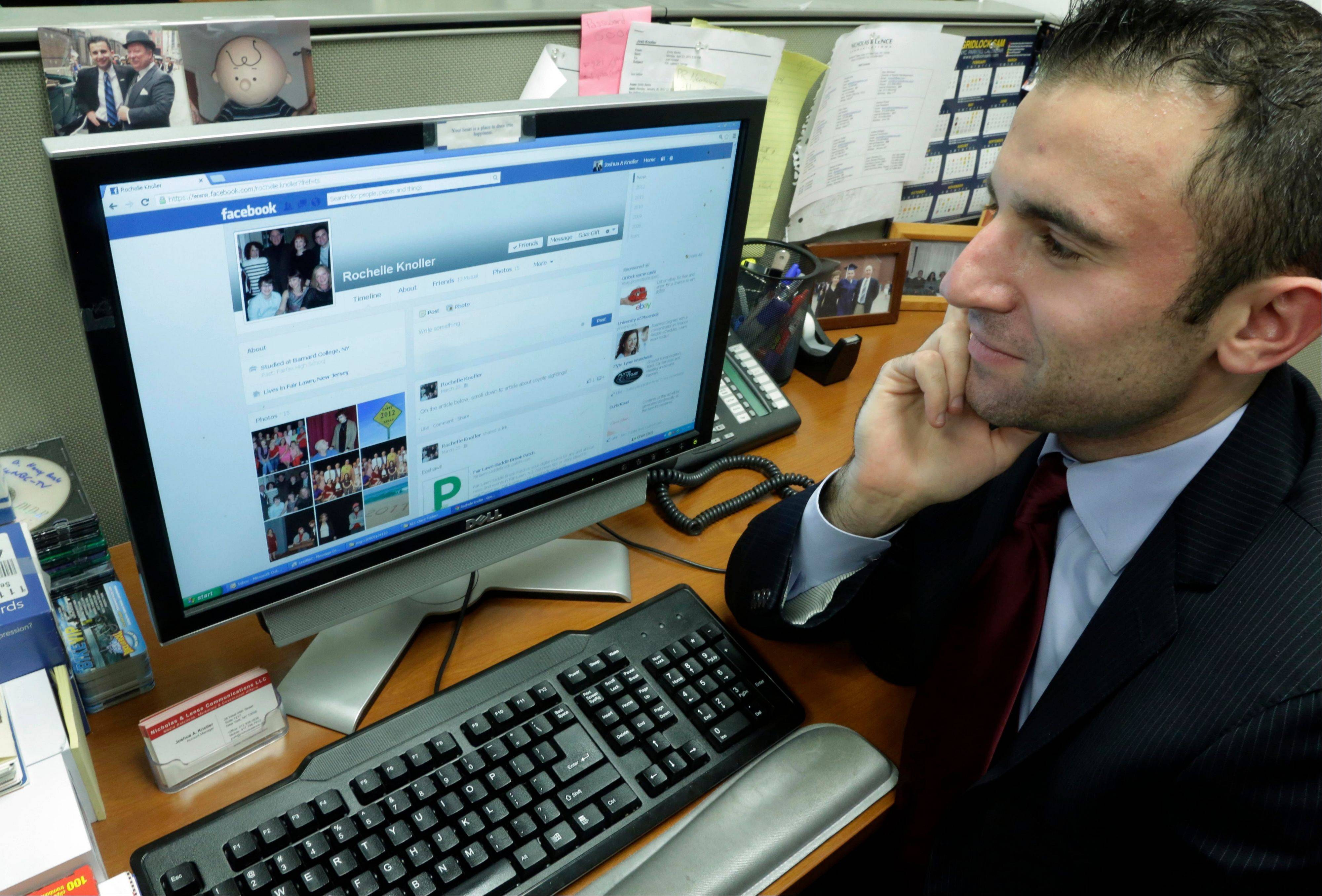 Joshua Knoller, an account manager with Nicholas & Lence Communications, looks at the Facebook page of his mother, Rochelle Knoller of Fair Lawn, N.J., on his office computer, in New York.