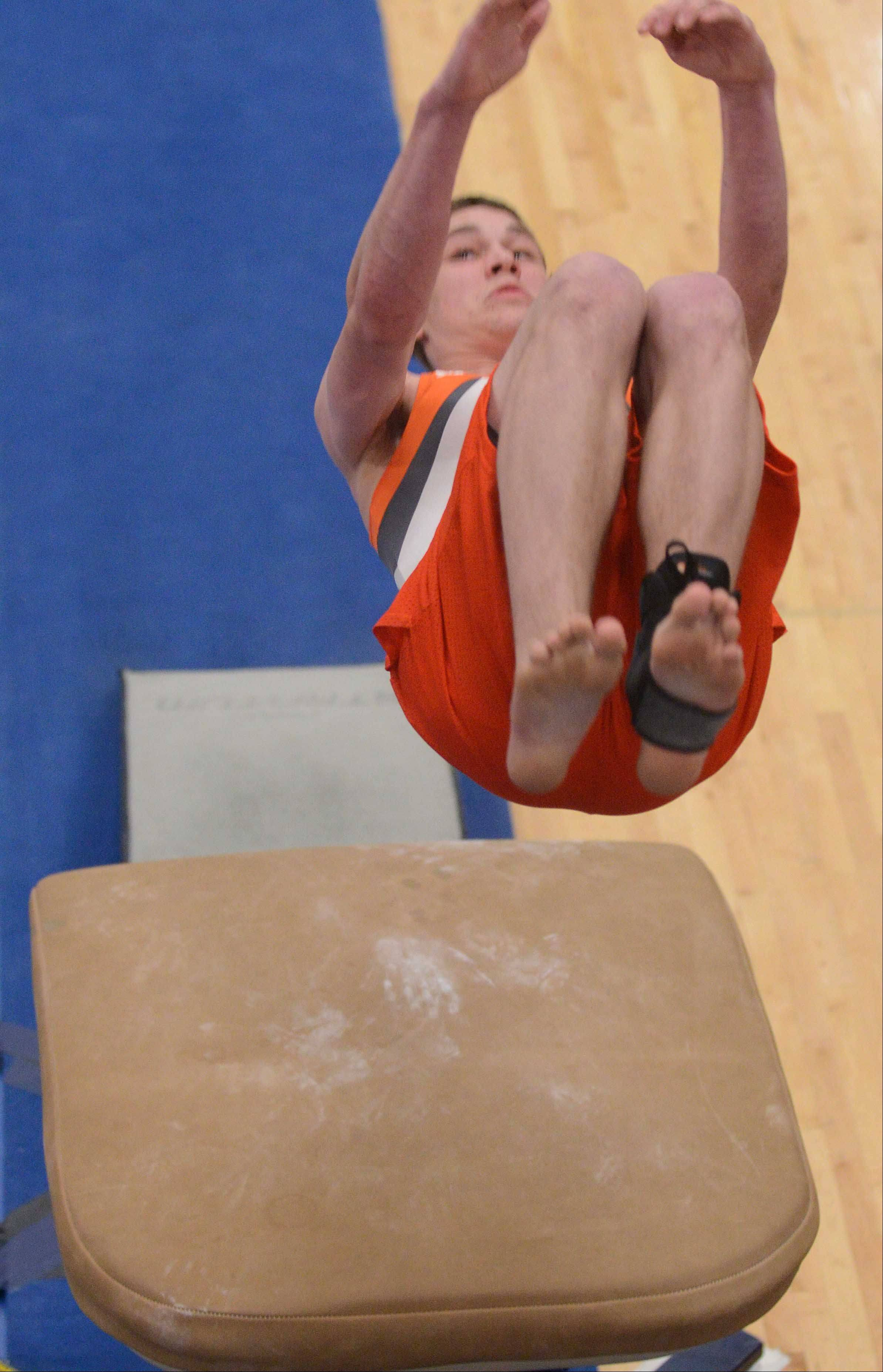 Matt Swanson of Hersey, on the vault during the boys gymnastics state finals at Lincoln-Way East on Saturday. He earned a tie for second.