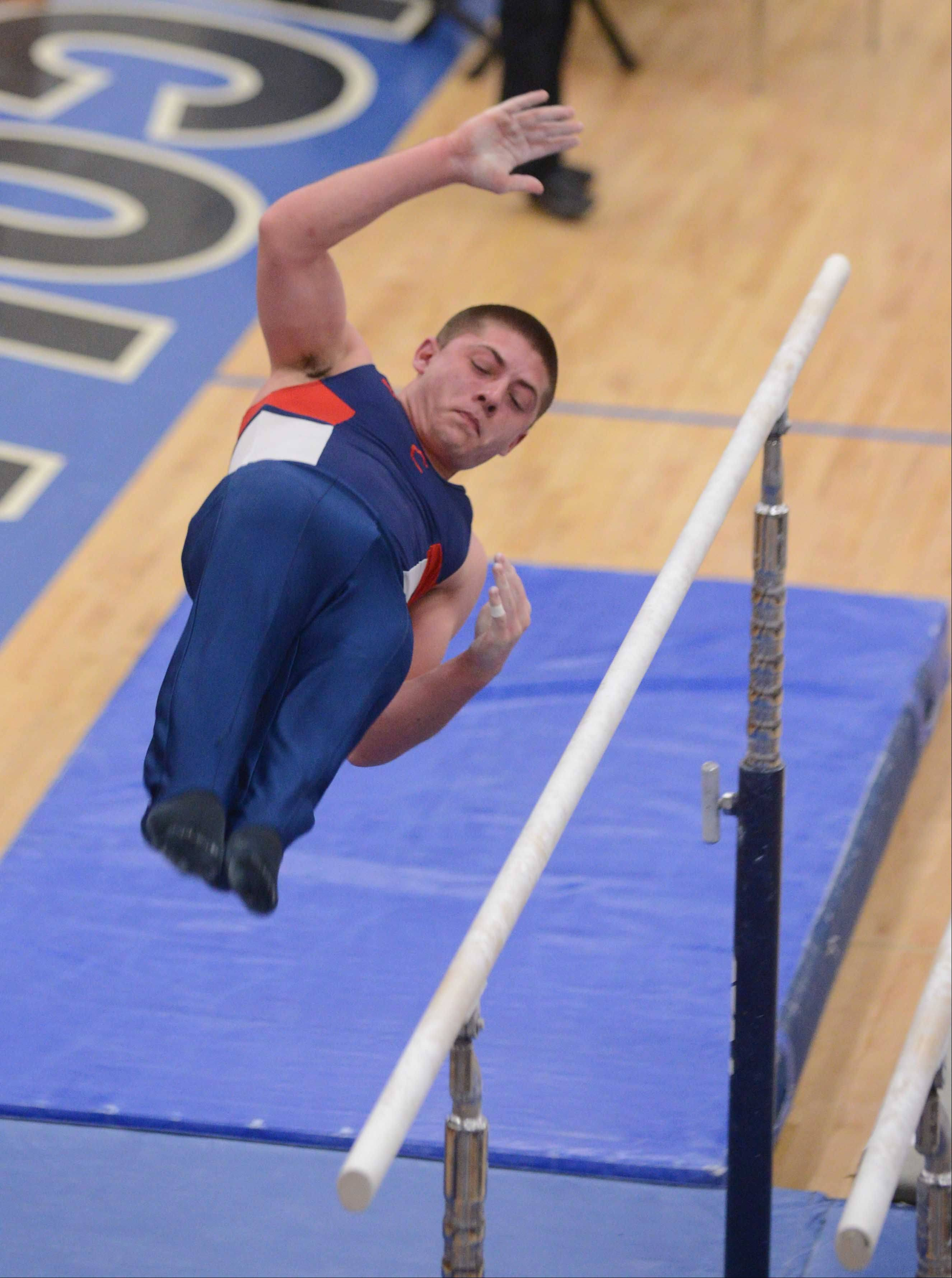 Joe Mauk of Conant performs on the parallel bars during the boys gymnastics state finals at Lincoln-Way East on Saturday.