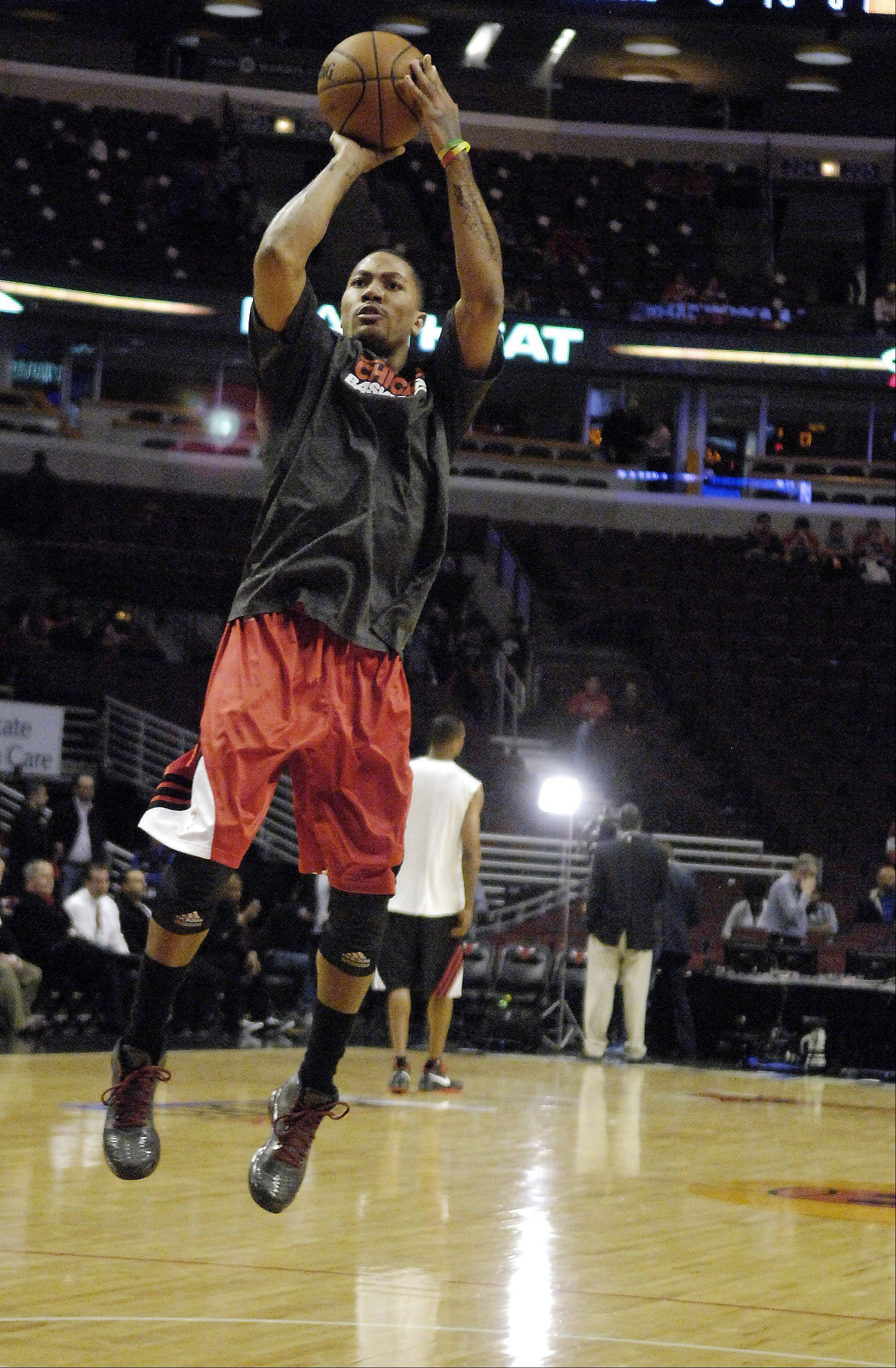 Injured Chicago Bulls point guard Derrick Rose (1) warms up before game 3 of the NBA Eastern Conference semifinals at the United Center in Chicago Friday.