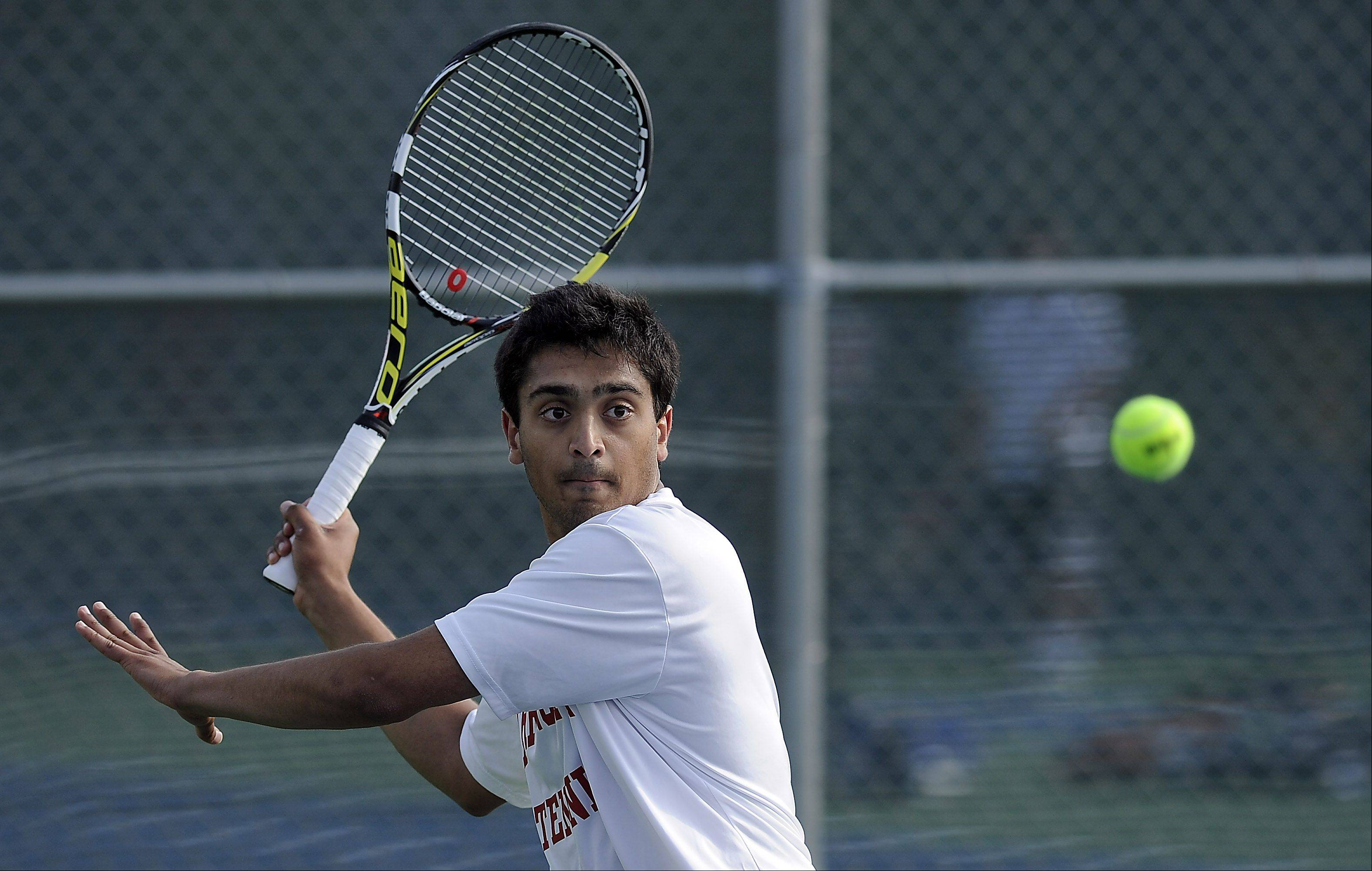 Barrington's Varun Parekh eyes the ball during his matchup with Conant's Peter Itskovich in the Mid-Suburban League No. 1 singles quarterfinals at Wheeling on Saturday morning.