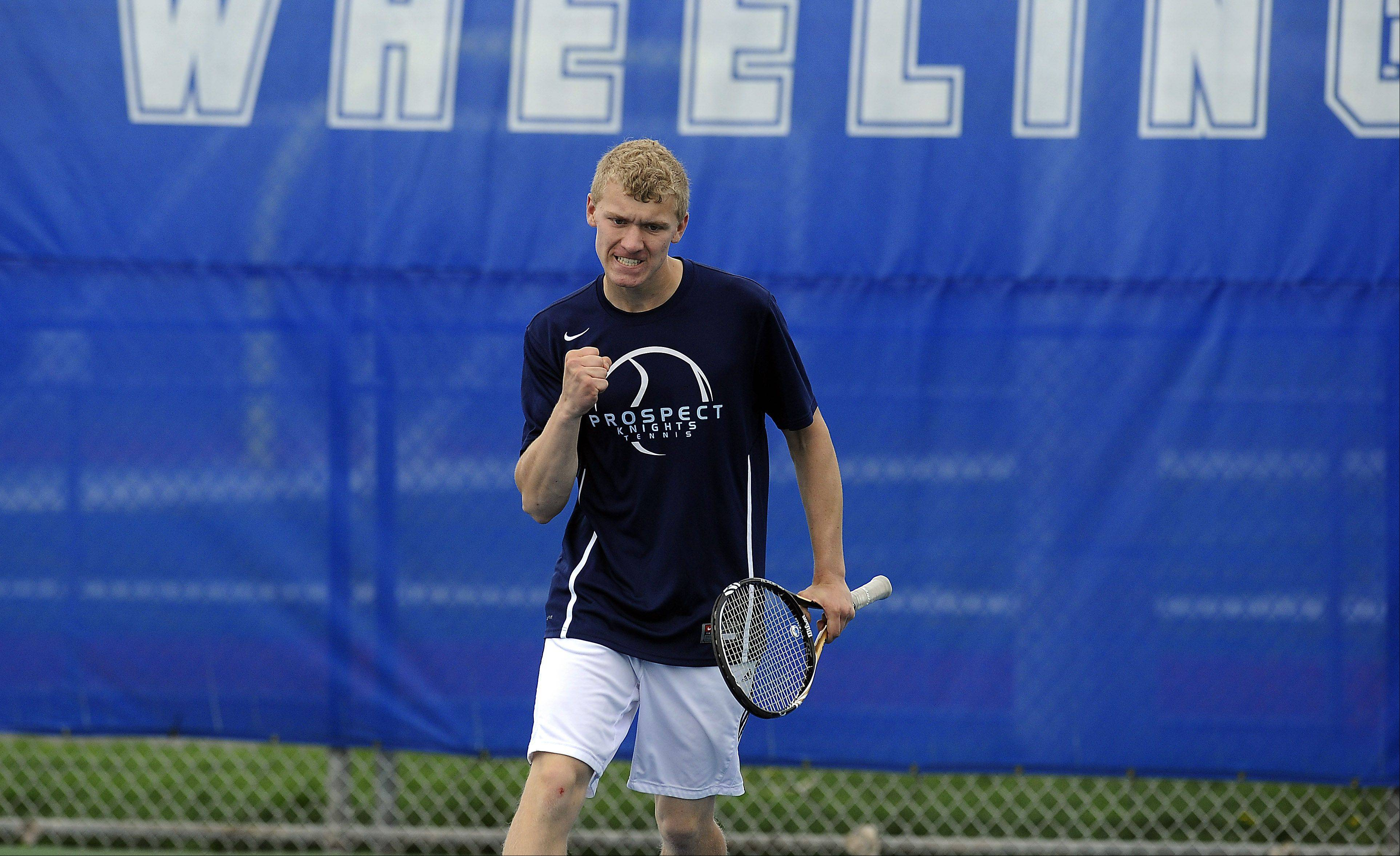 Carson Burke of Prospect pumps his fist after he scores a point against Fremd's Maciej Niemcyzk in the Mid-Suburban League No. 1 singles quarterfinals at Wheeling on Saturday.