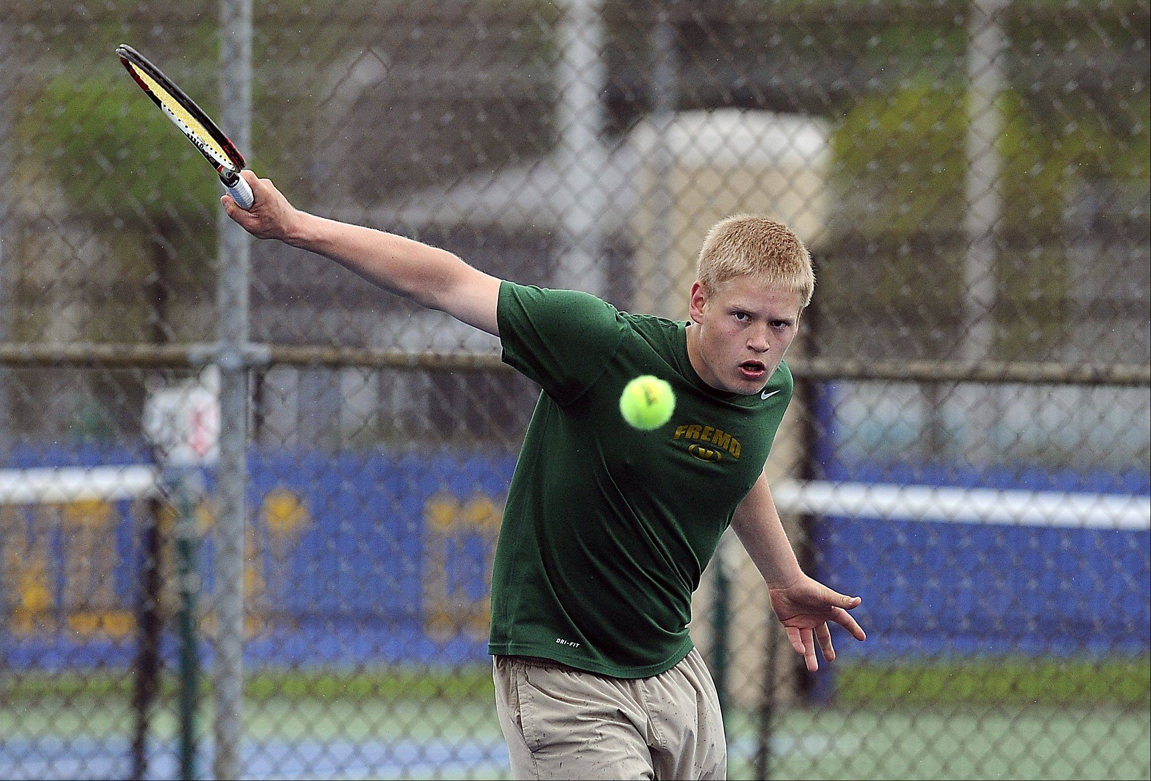 Fremd's Maciej Niemcyzk hits a return against Carson Burke of Prospect in the Mid-Suburban League No. 1 singles quarterfinals at Wheeling on Saturday.