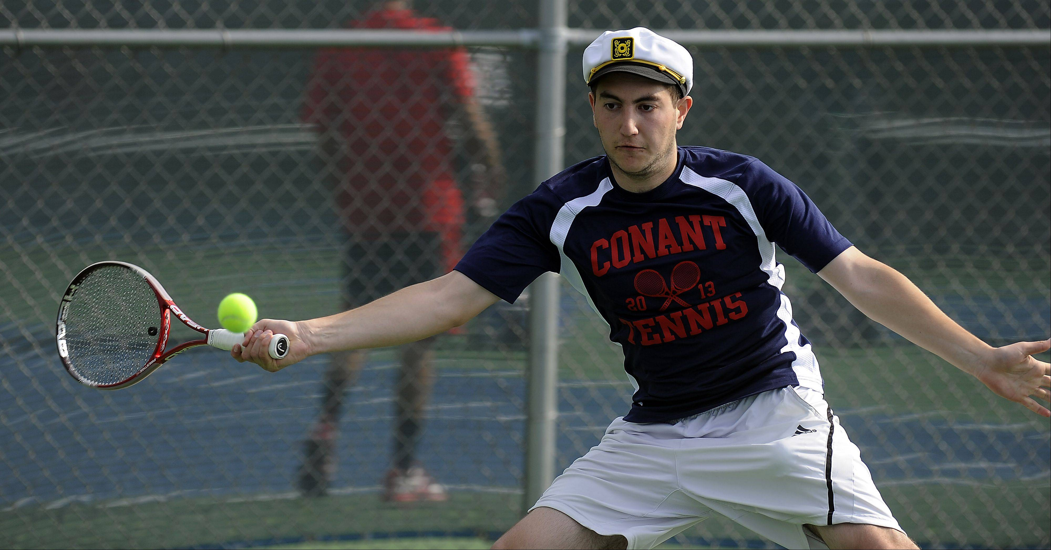 Conant's Peter Itskovich eyes the ball during his matchup with Barrington's Varun Parekh during the Mid-Suburban League No. 1 singles quarterfinals at Wheeling on Saturday.
