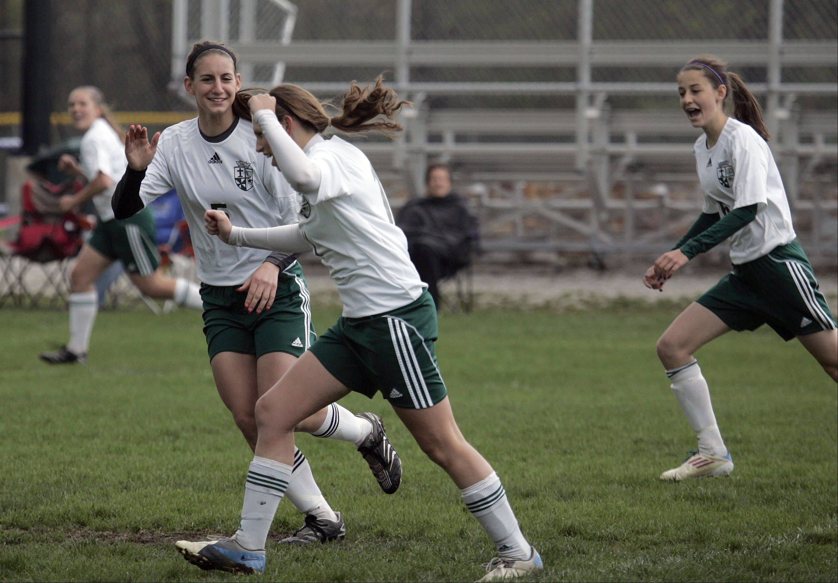 St. Edward's Allison Kruk celebrates after scoring the game's first goal Saturday during the Green Wave's 7-0 win over Westminster Christian in the Class 1A Westminster regional title game.