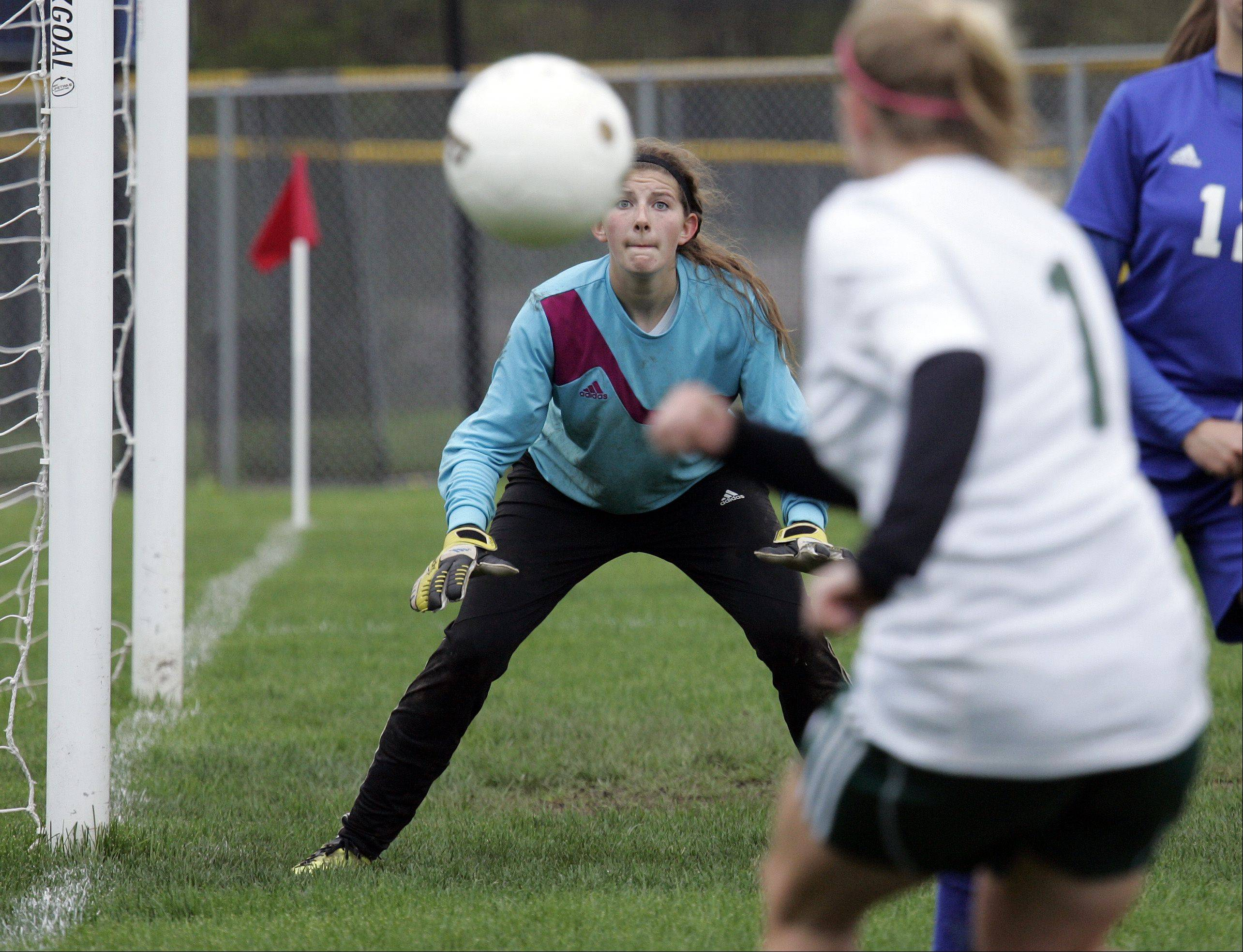 Westminster goalkeeper Savannah Dutcher keeps her eye on a shot by Corey Lepoudre of St. Edward Saturday.