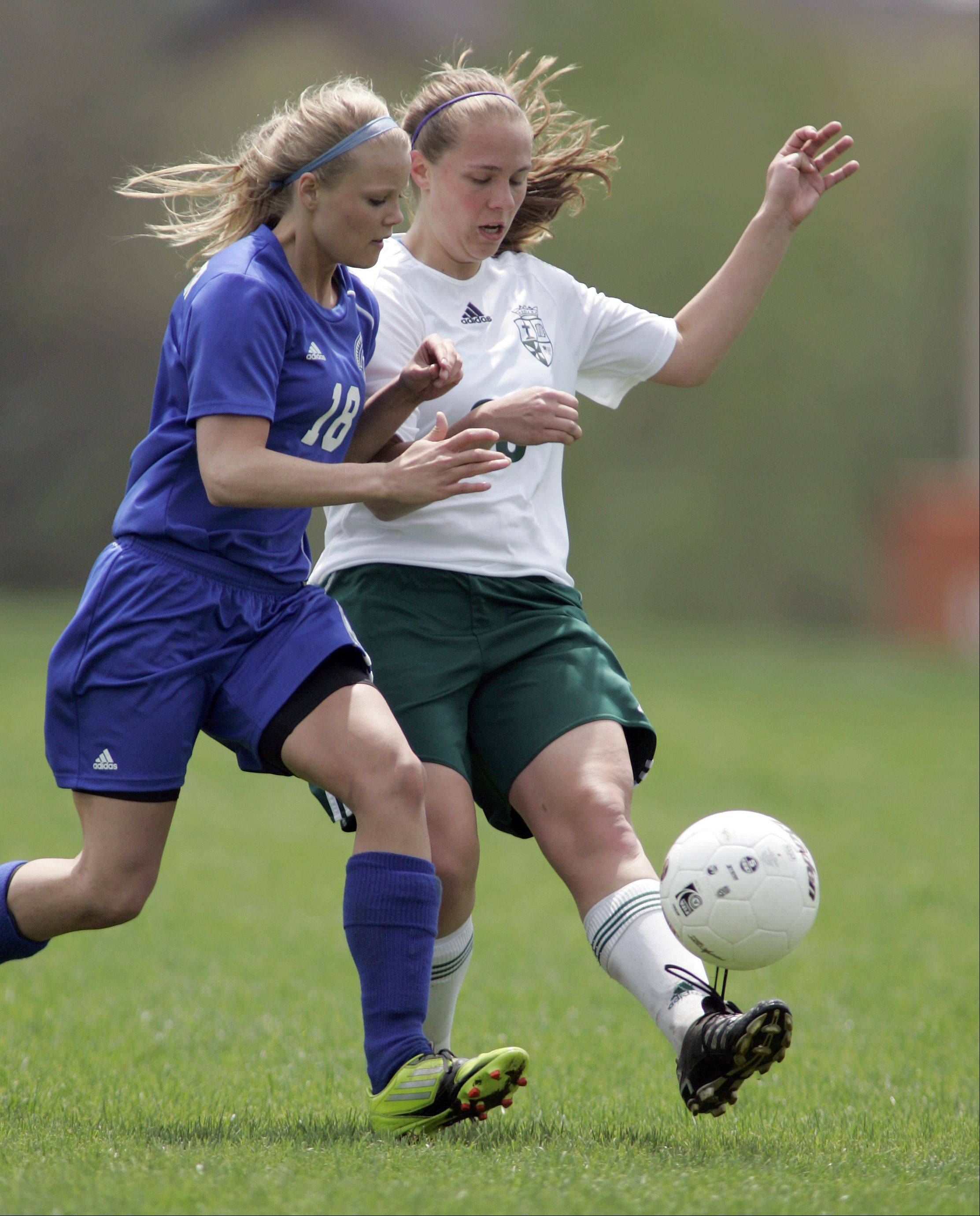 Westminster's McKaila Hays pressures Casey Gredzieleski of St. Edward Saturday.