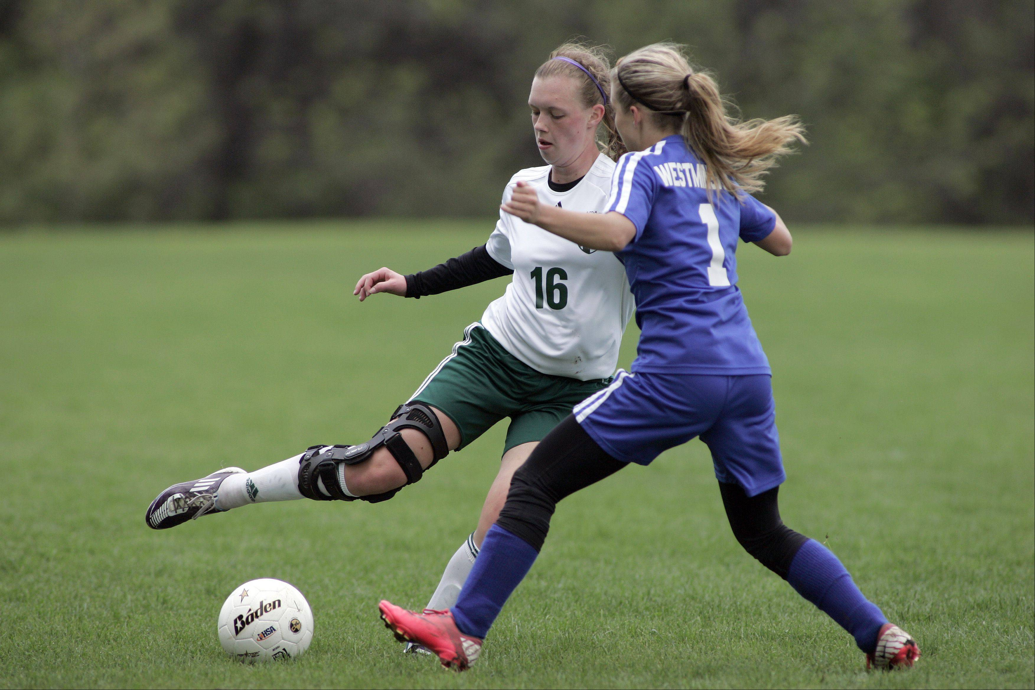 St. Edward's Olivia Kochanek works to get around Westminster's Alexa Pedersen Saturday.