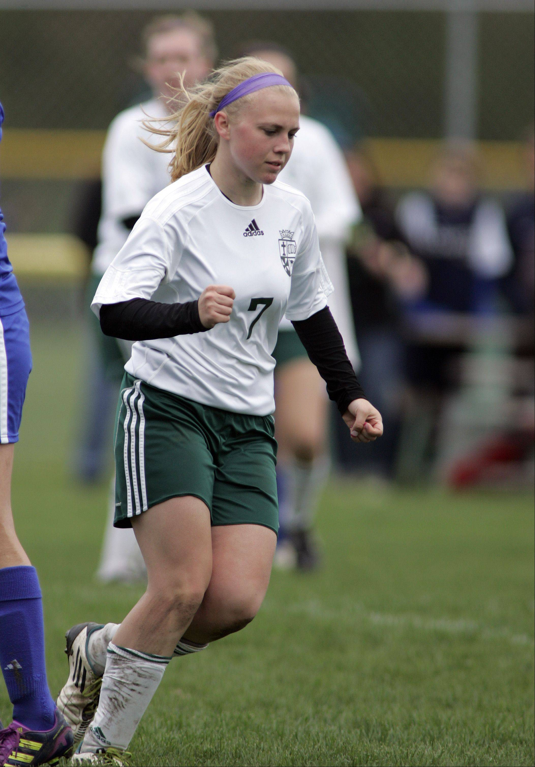 St. Edward's Kim Smith reacts after scoring a goal Saturday.