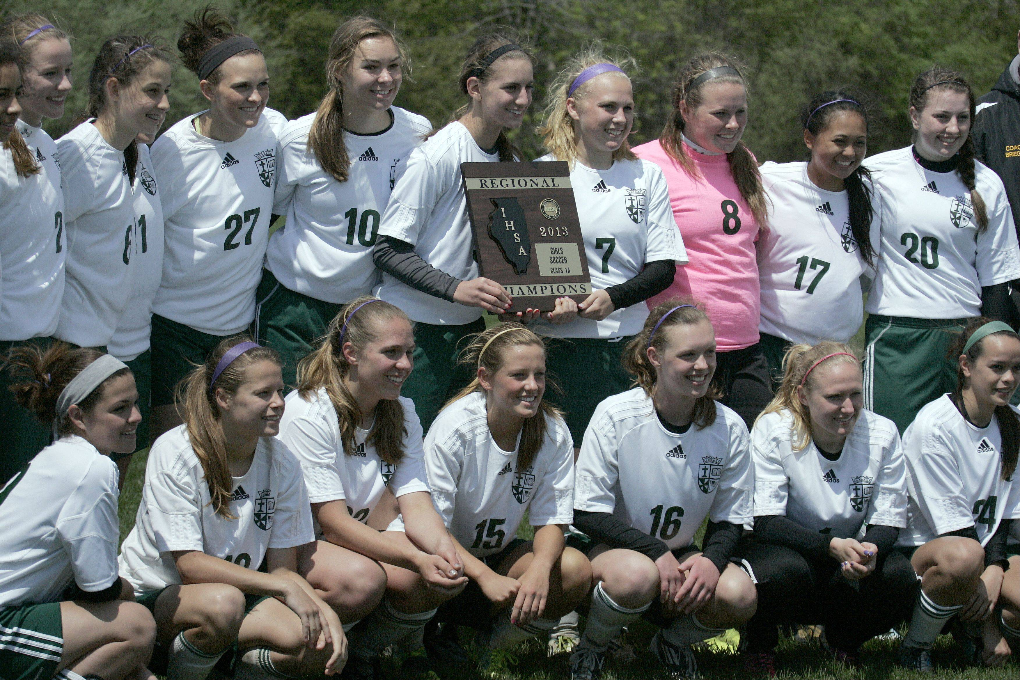 St. Edward's girls soccer team poses for a picture Saturday after winning the Class 1A Westminster Christian regional championship.