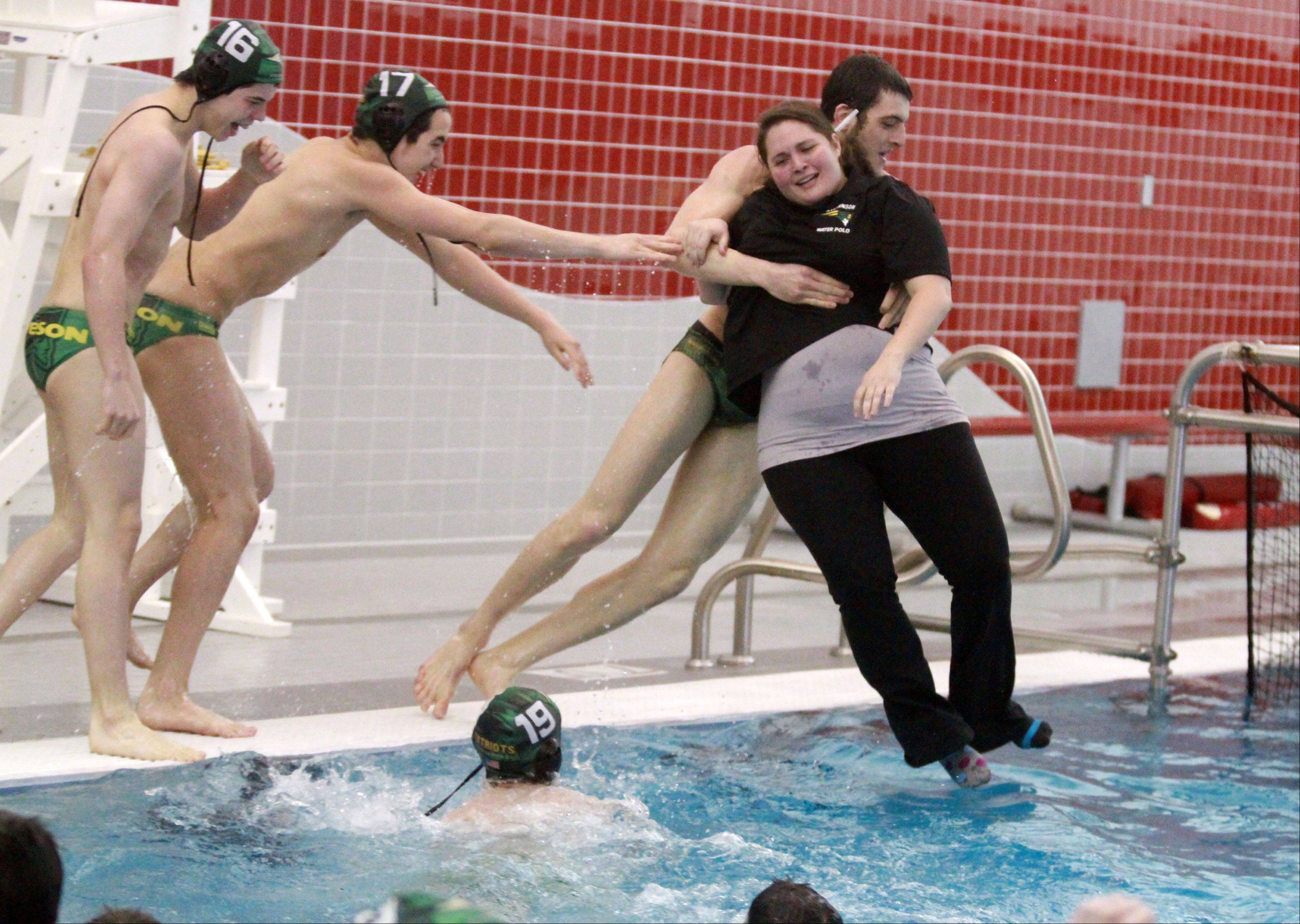 Stevenson's Remy Dalloul throws assistant coach Rose Schiavone in the pool after other players threw head coach Sean Wimer in as they celebrate a sectional championship.