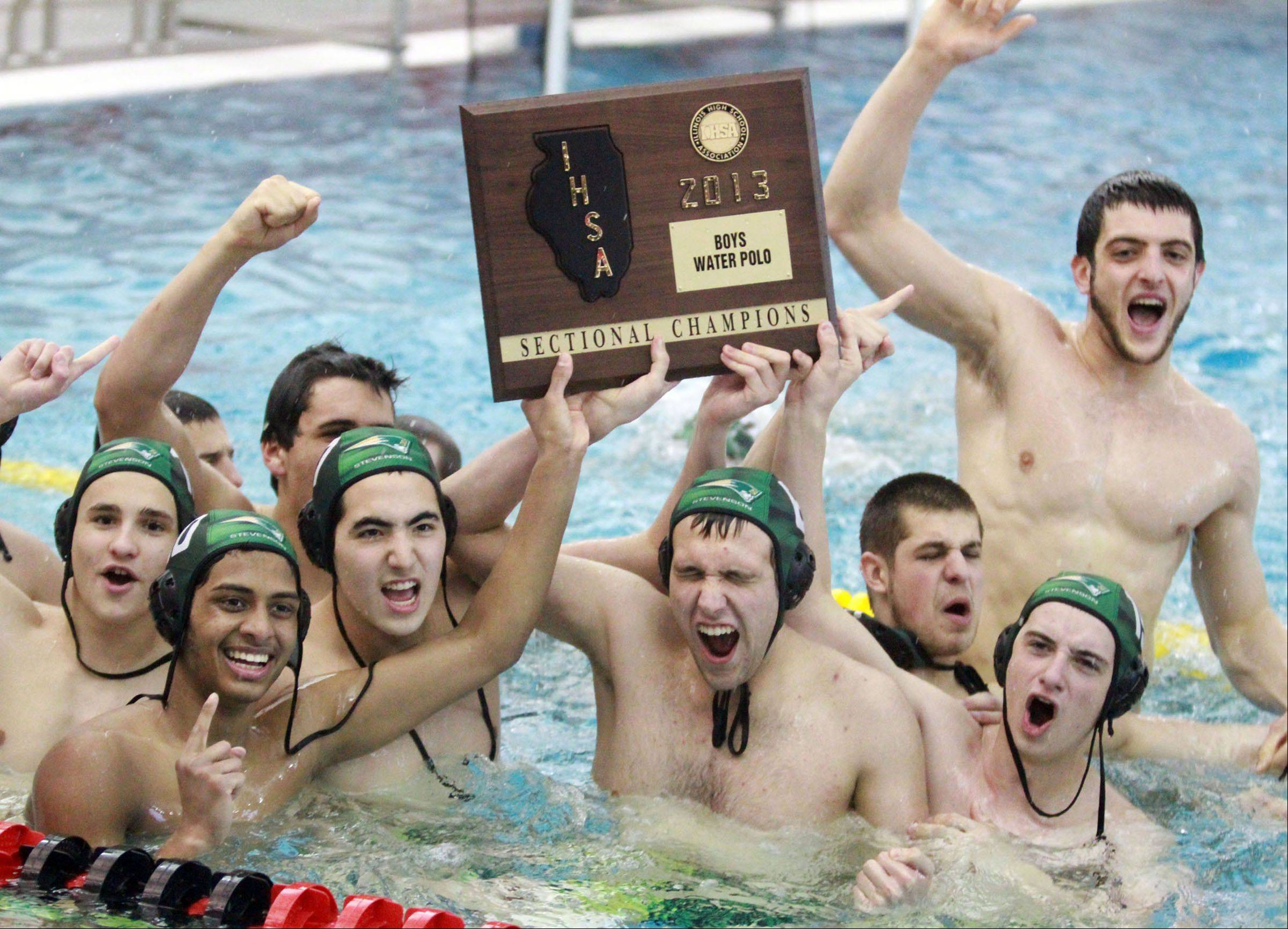 Stevenson players celebrating in the pool after topping Palatine for the Mundelein sectional championship.