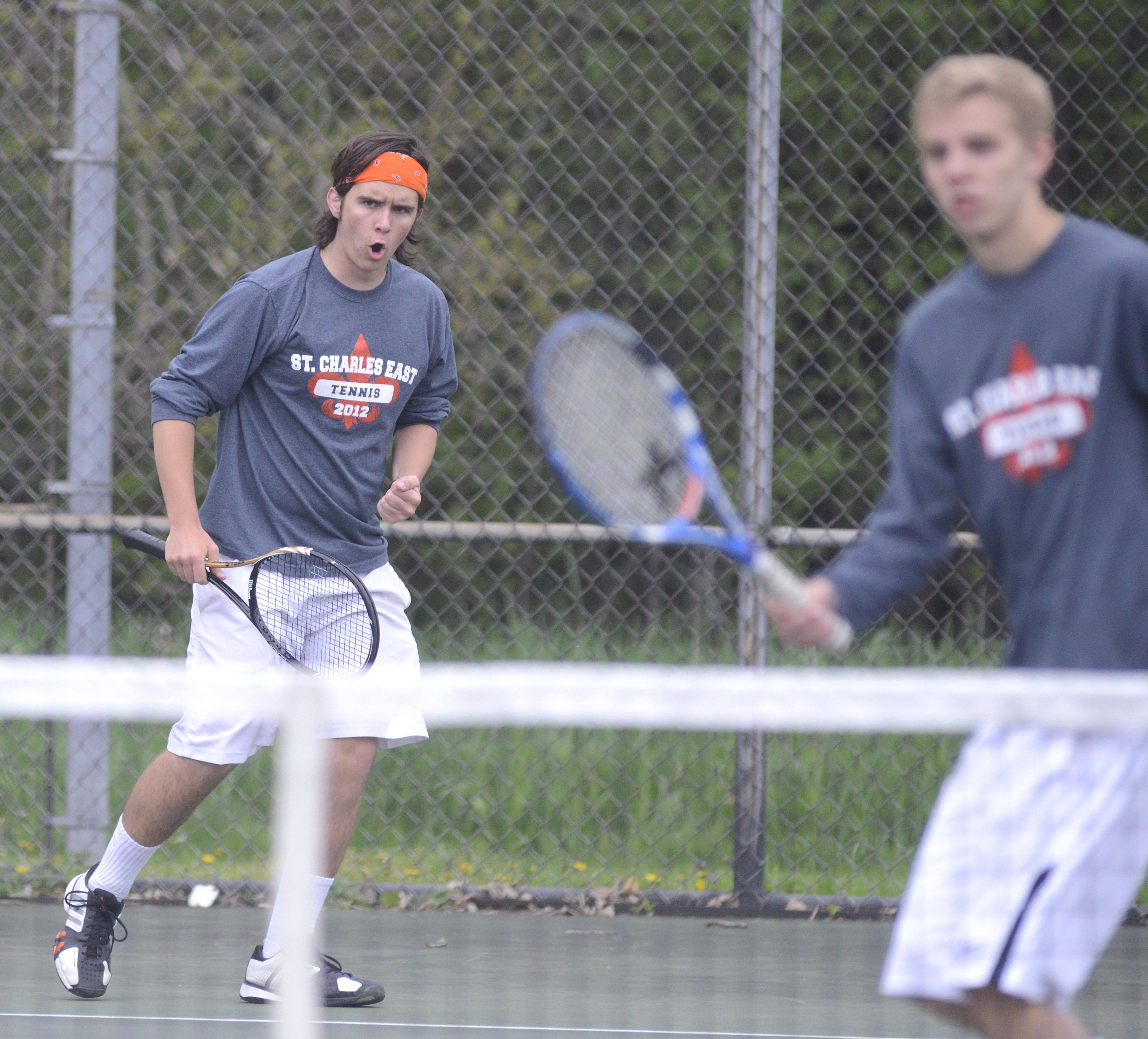"St. Charles East's George Spoerl shouts ""Let's go!"" after winning a point in the first doubles third place match with teammate Matt McCarthy vs. St. Charles North in the Upstate Eight Conference at Elgin High School on Saturday, May 11."