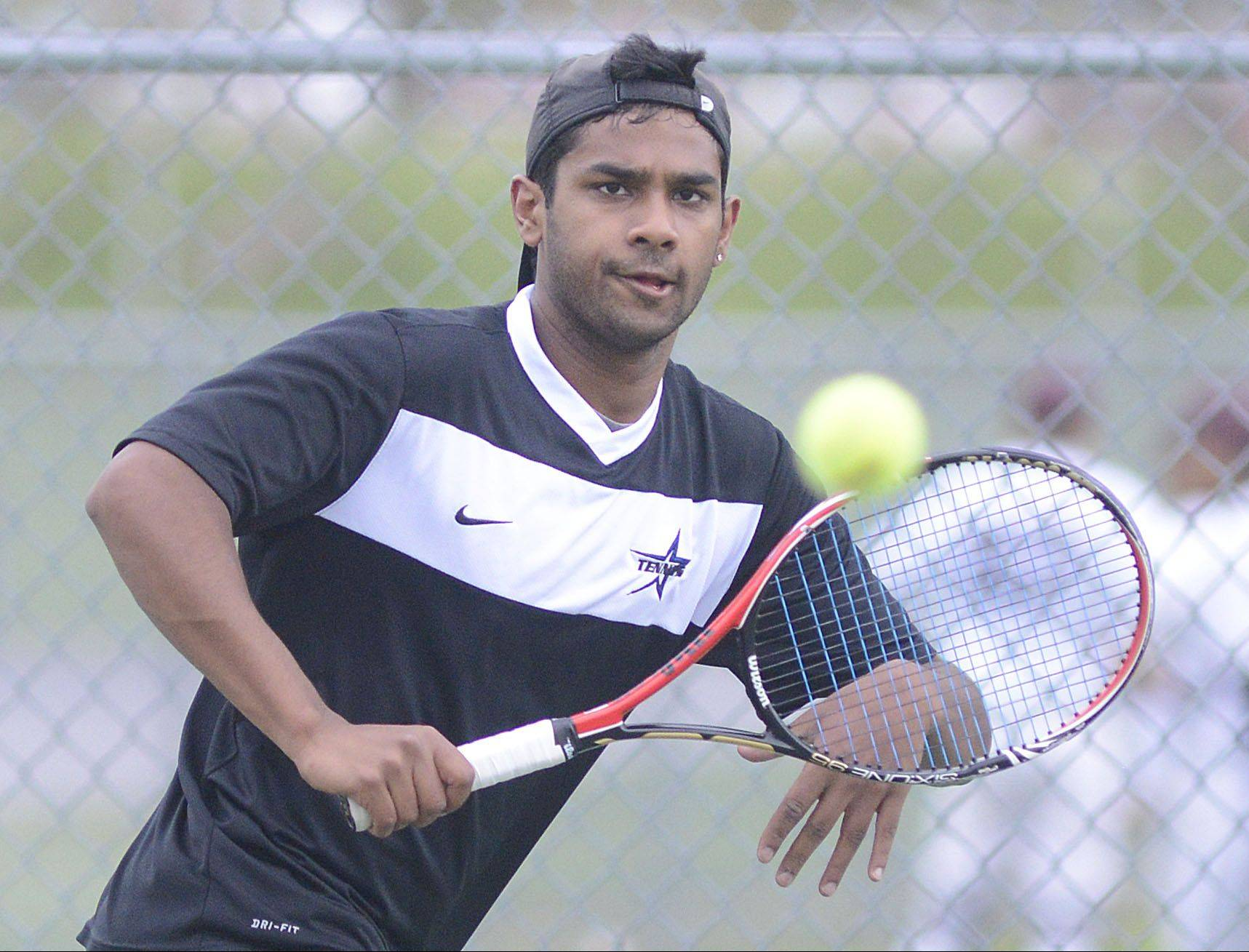 St. Charles North's Dom Amalraj won the No. 1 singles title Saturday.