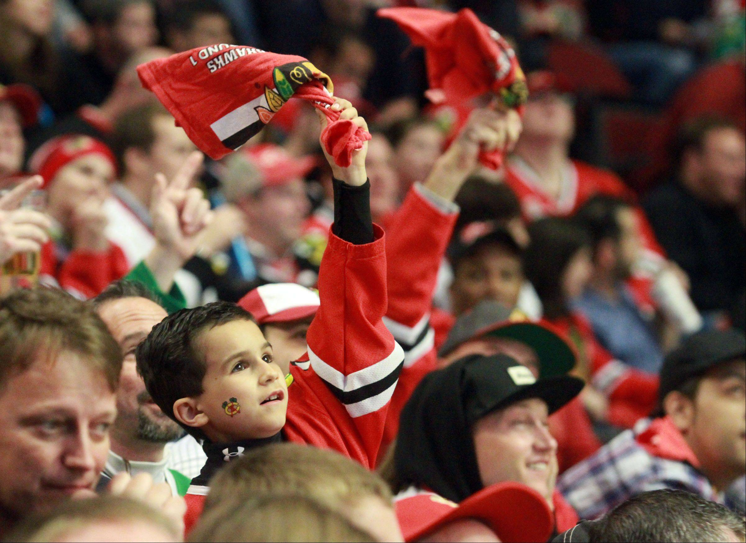 Young or old, Blackhawks fans love to dress the part and show their true colors in support of the franchise.