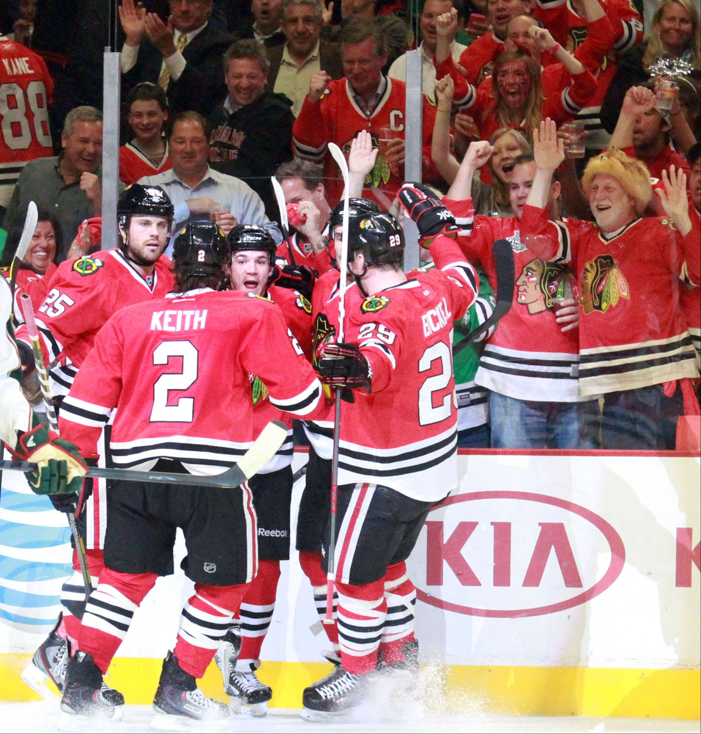 With fans on their feet, the Blackhawks celebrate a goal by center Andrew Shaw in Game 5 of their Western Conference first-round playoff series against Minnesota.