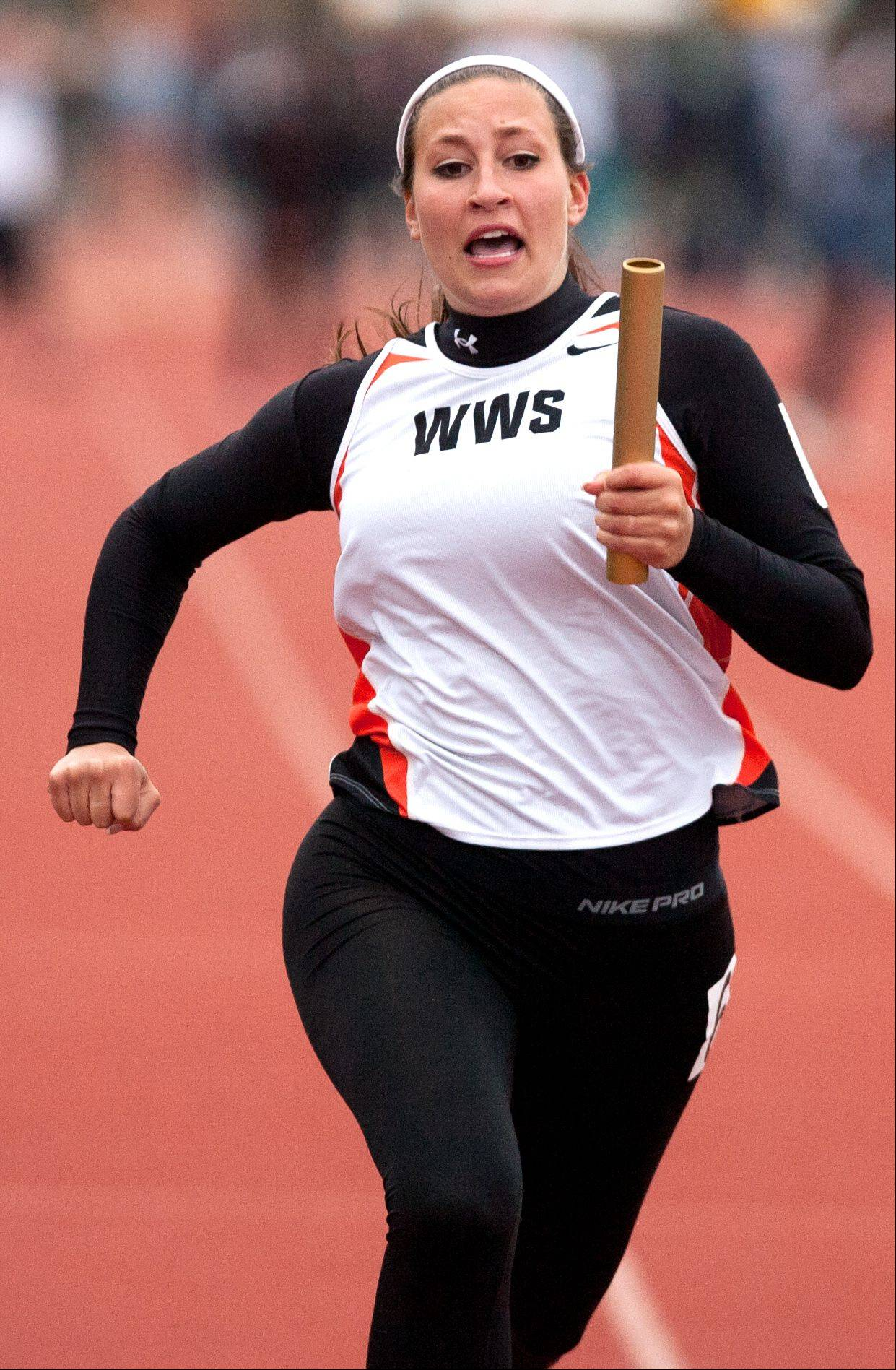 Wheaton Warrenville South's Jenny Fiola sprints to a 4 x 100 Meter Relay second place finish during the York Girls Track and Field Sectional meet.