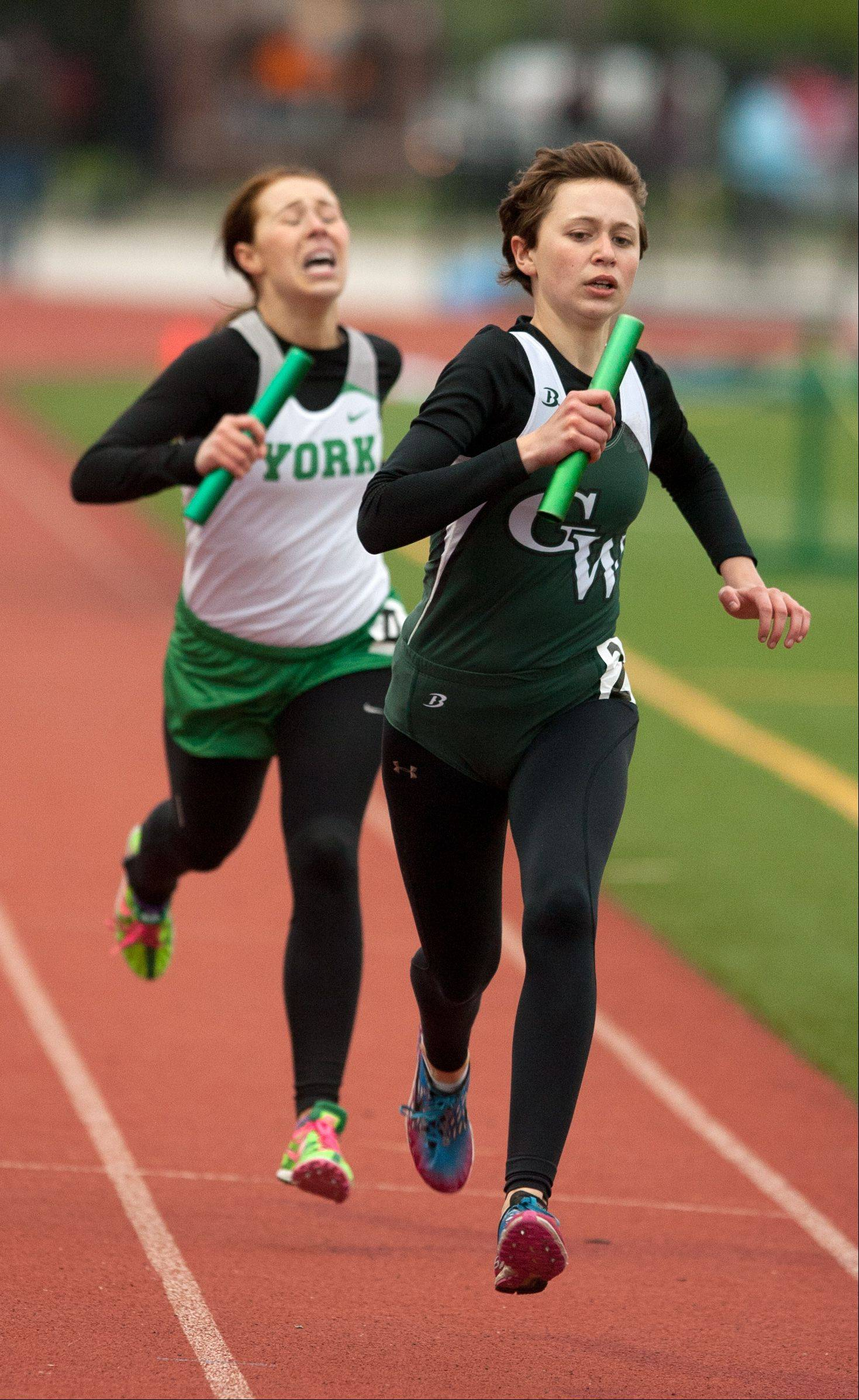 Glenbard West's Christina Sedall anchors a 3,200 Meter Relay second play finish over York's Alyssa Adam during the York Girls Track and Field Sectional meet.