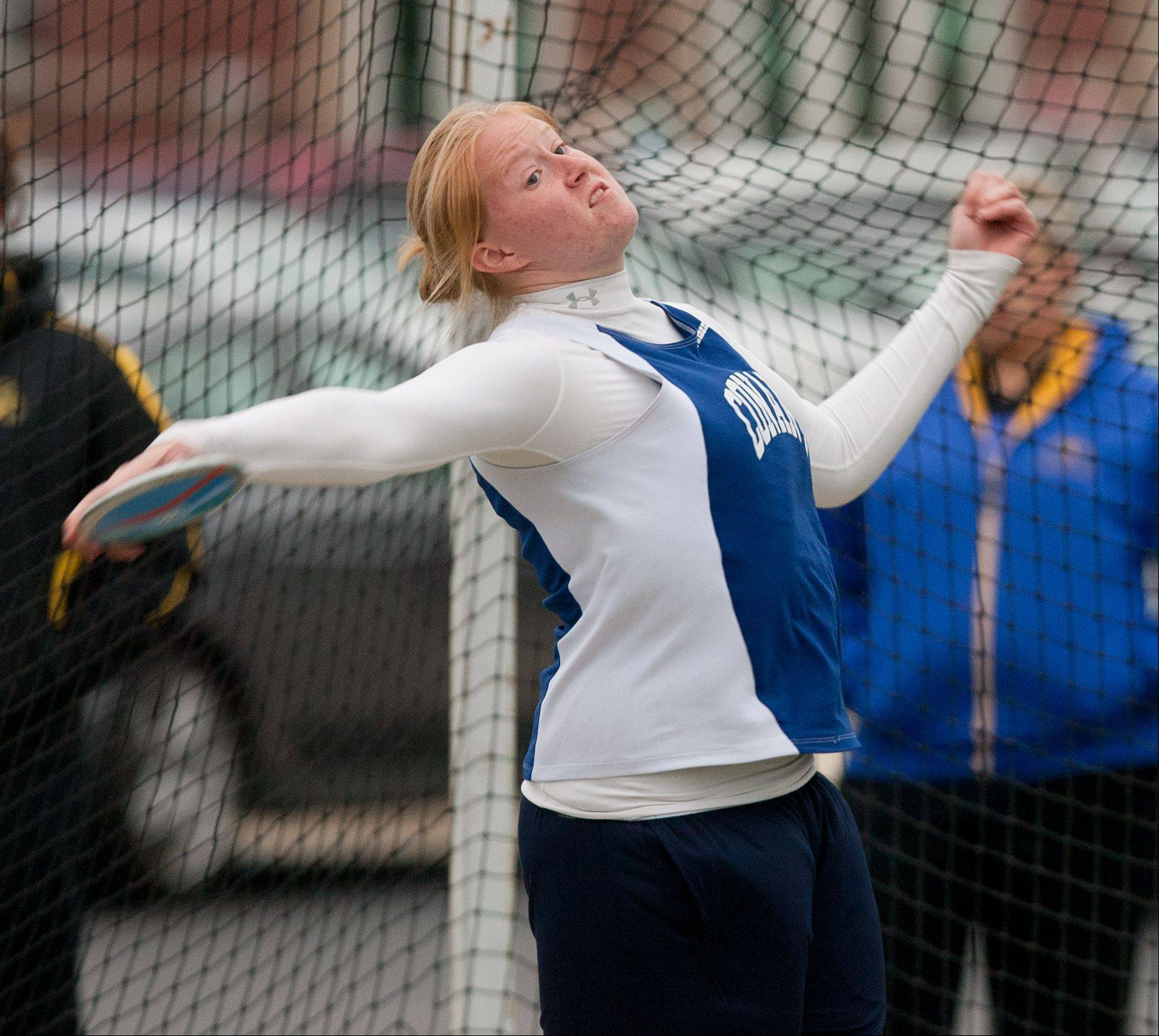 Conant's Katie Prince throws the discus during the York Girls Track and Field Sectional meet.