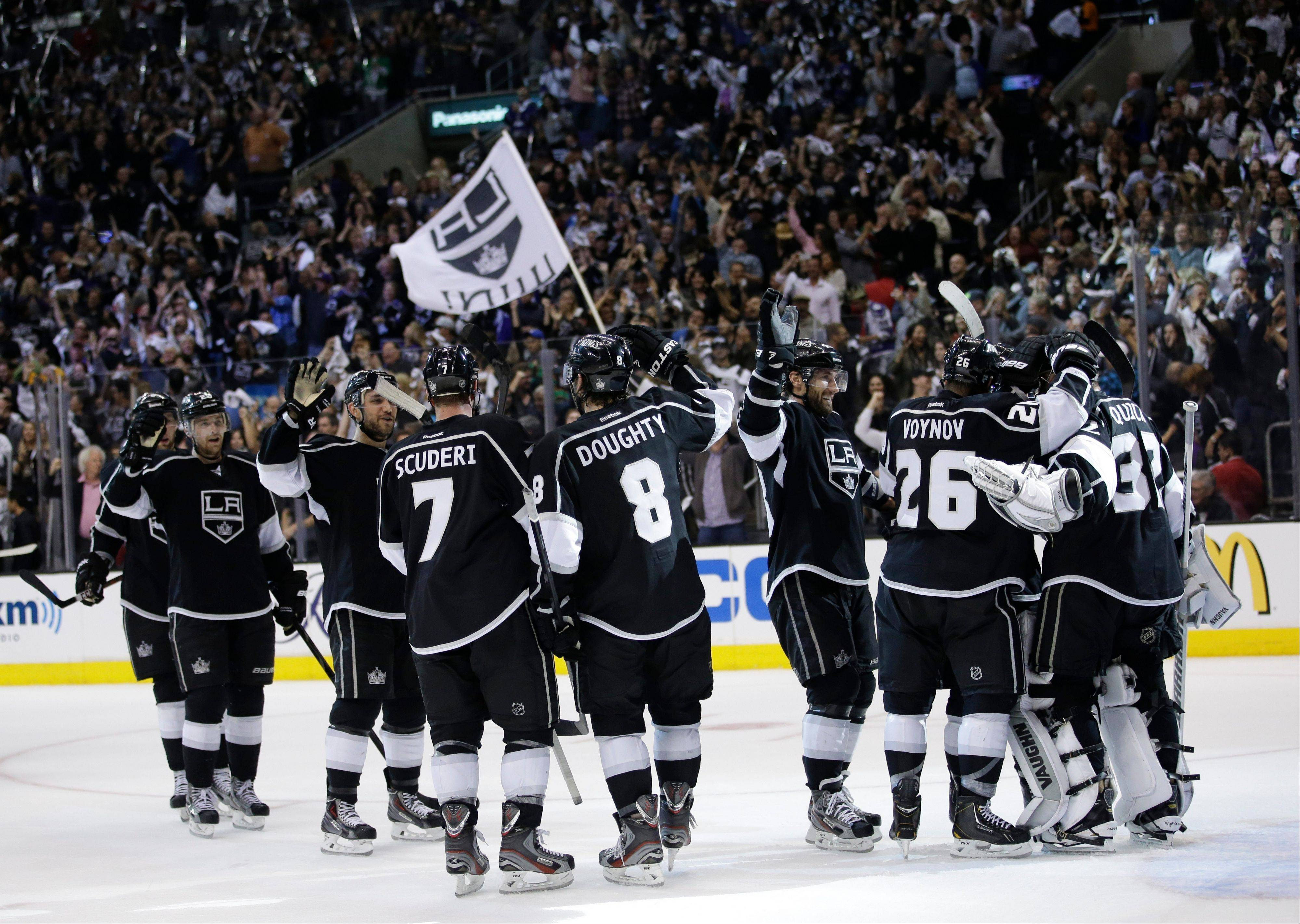 The Los Angeles Kings celebrate their team's 2-1 win against the St. Louis Blues after Game 6 of a first-round NHL hockey Stanley Cup playoff series in Los Angeles, Friday, May 10, 2013.