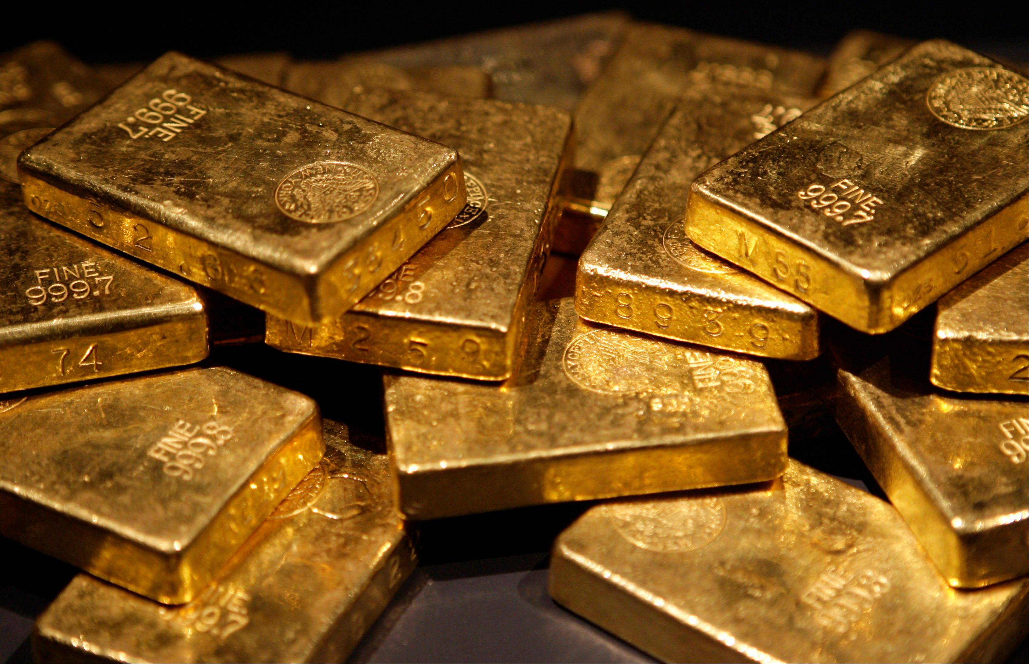 Gold bars are on display at the �Gold� exhibit in the American Museum of Natural History in New York. Gold, often touted as the most trustworthy of investments, has looked wild over the past month.