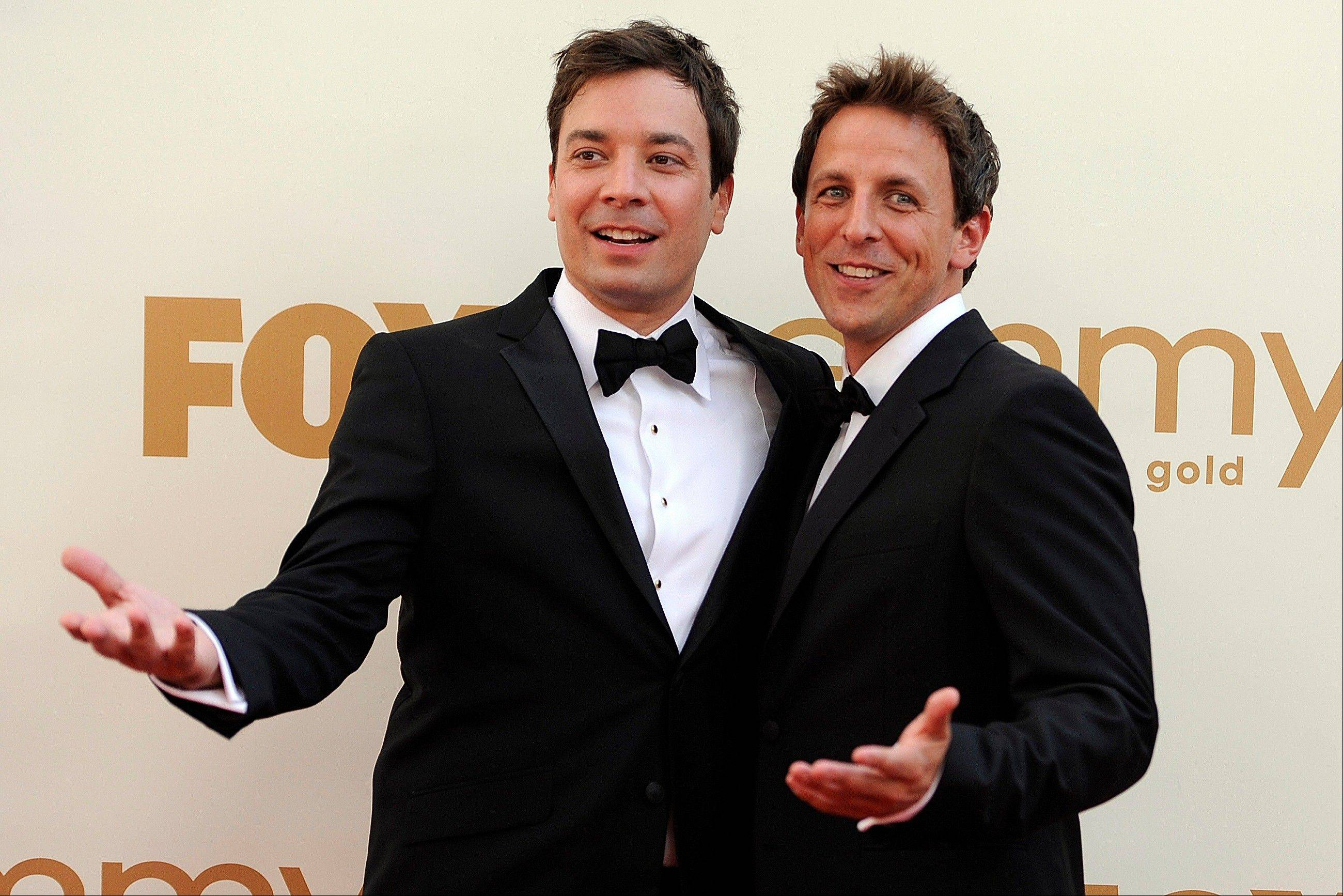 "Seth Meyers, right, is moving from his ""Weekend Update"" desk on ""Saturday Night Live"" to his own late-night show on NBC in Jimmy Fallon's old time slot."
