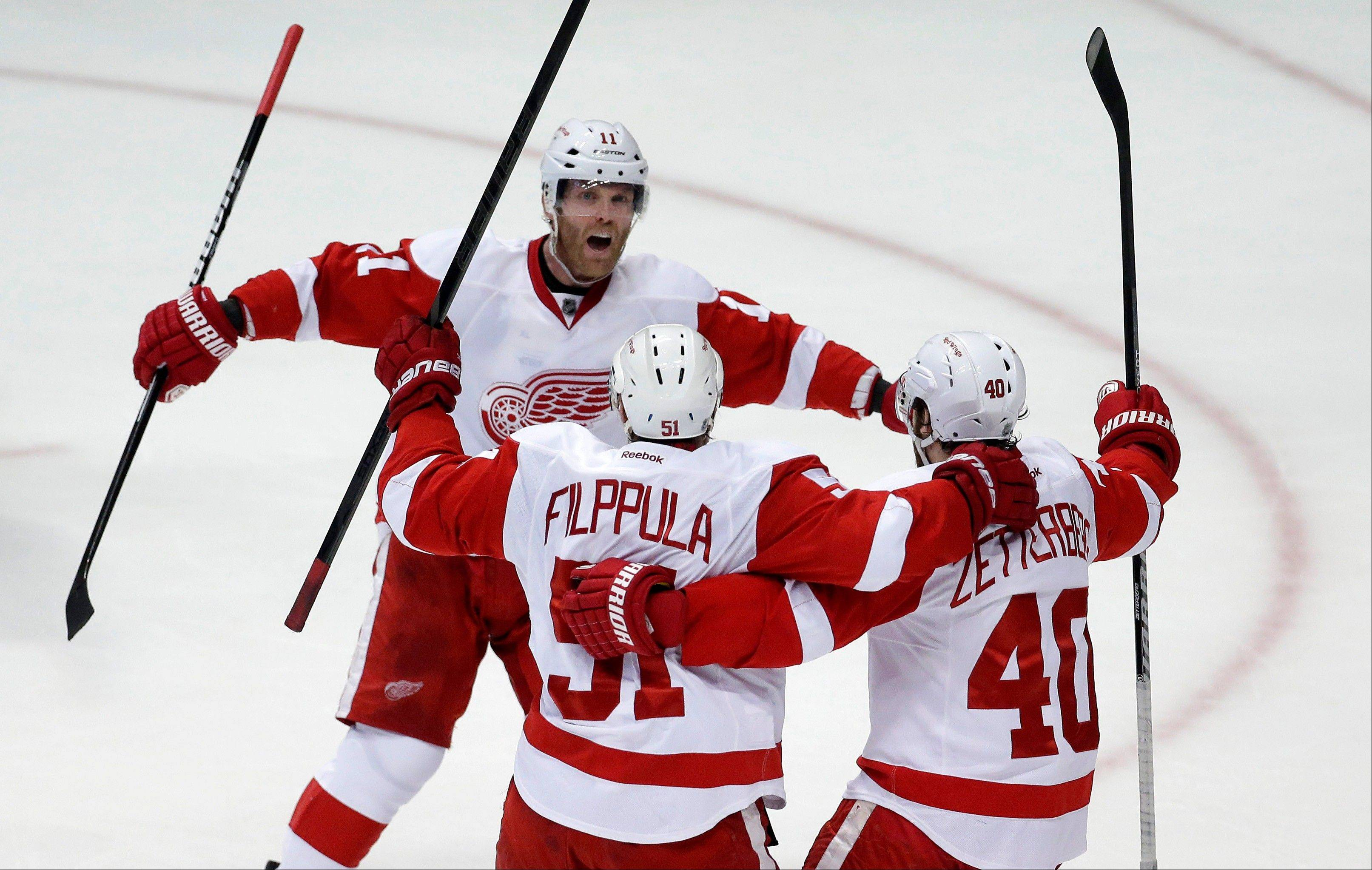 Detroit Red Wings forward Valtteri Filppula, center, celebrates his goal Sudnay with right wing Daniel Cleary, left, and center Henrik Zetterberg during the second period in Game 7 of their first-round NHL hockey Stanley Cup playoff series against the Anaheim Ducks.