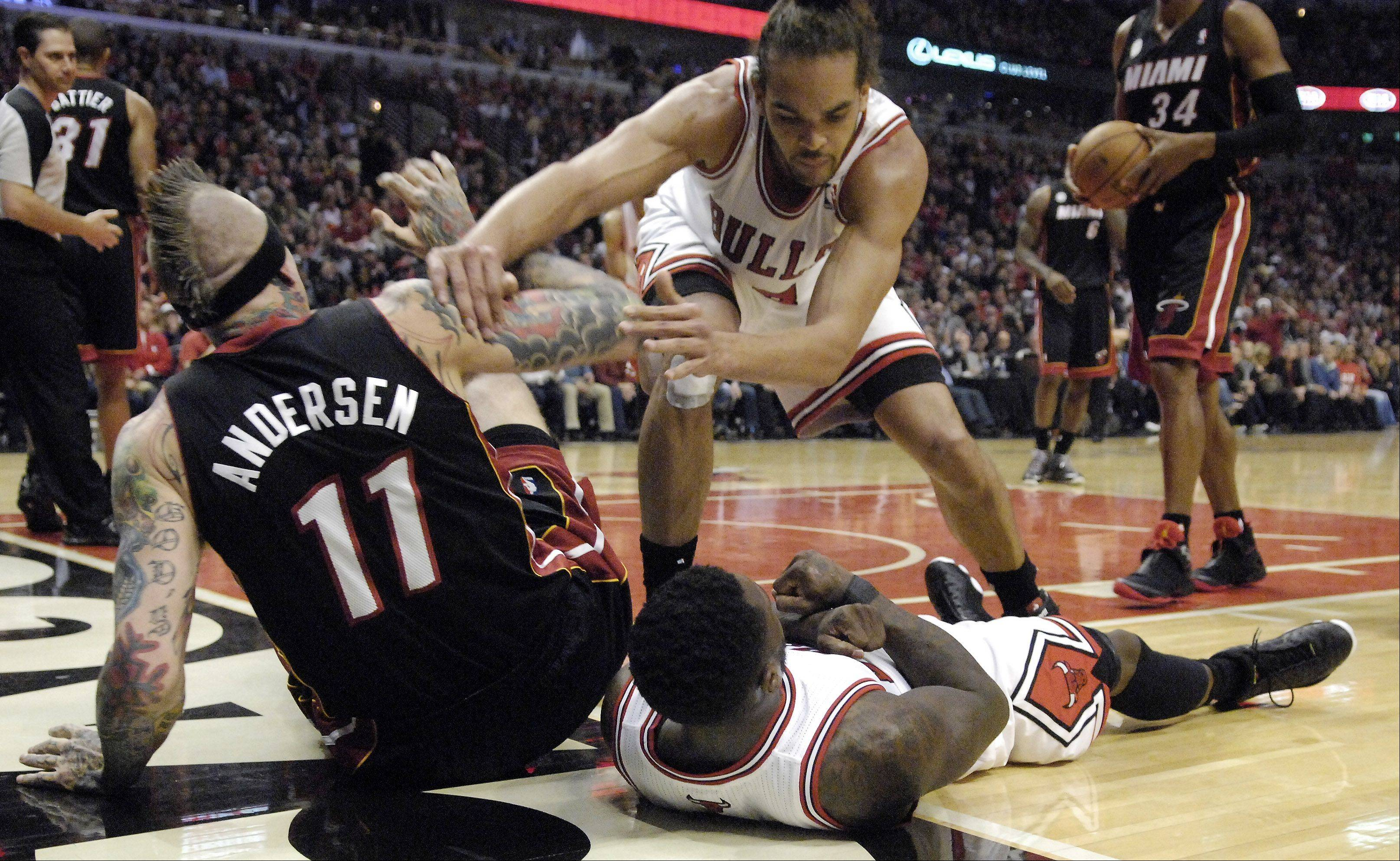 Bulls center Joakim Noah pushes Heat forward Chris Andersen off teammate Nate Robinson in Game 3 on Friday. Noah received a technical foul.