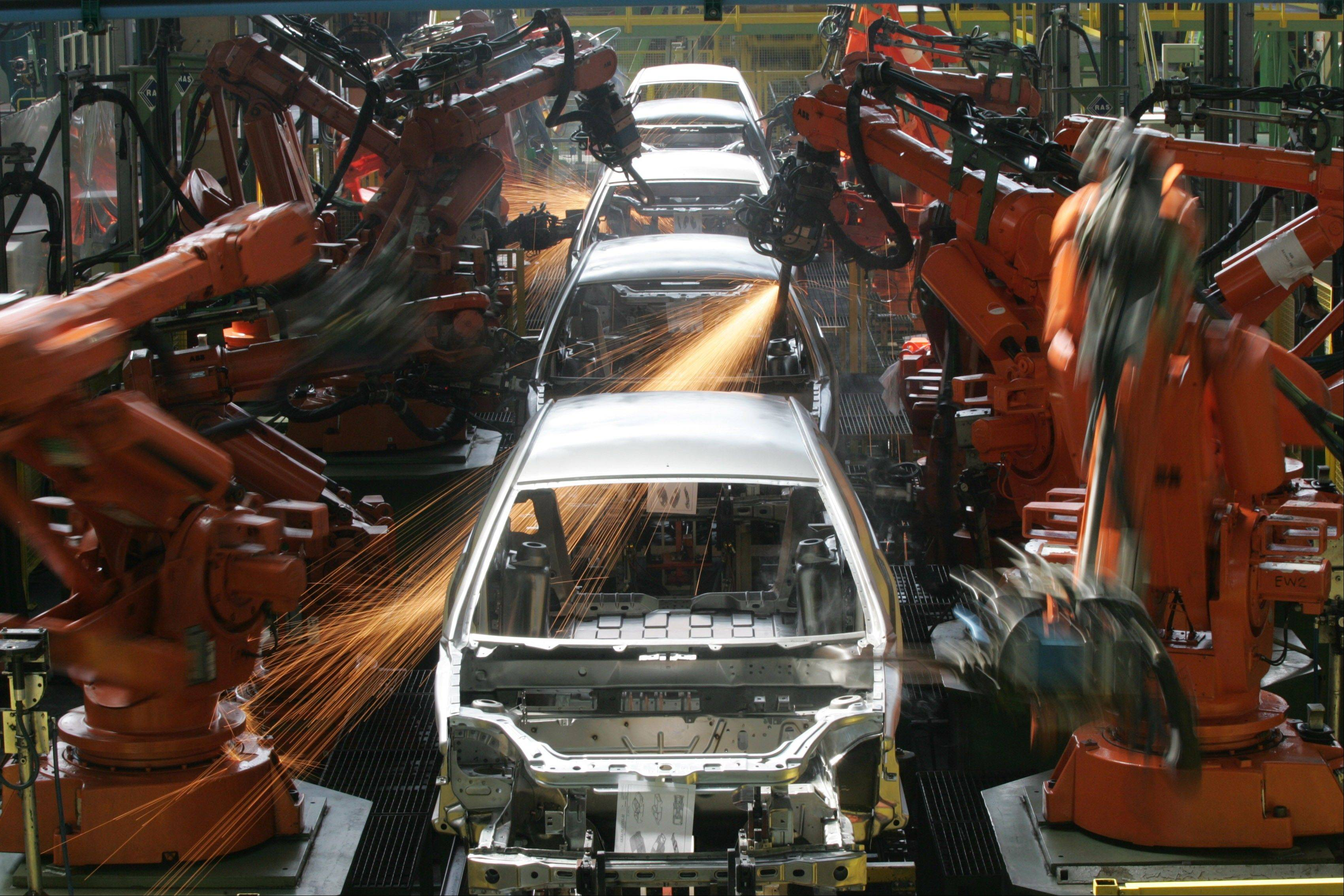 Associated Press/March 6, 2008 Ford Ka cars are assembled in Sao Bernardo do Campo, Brazil.