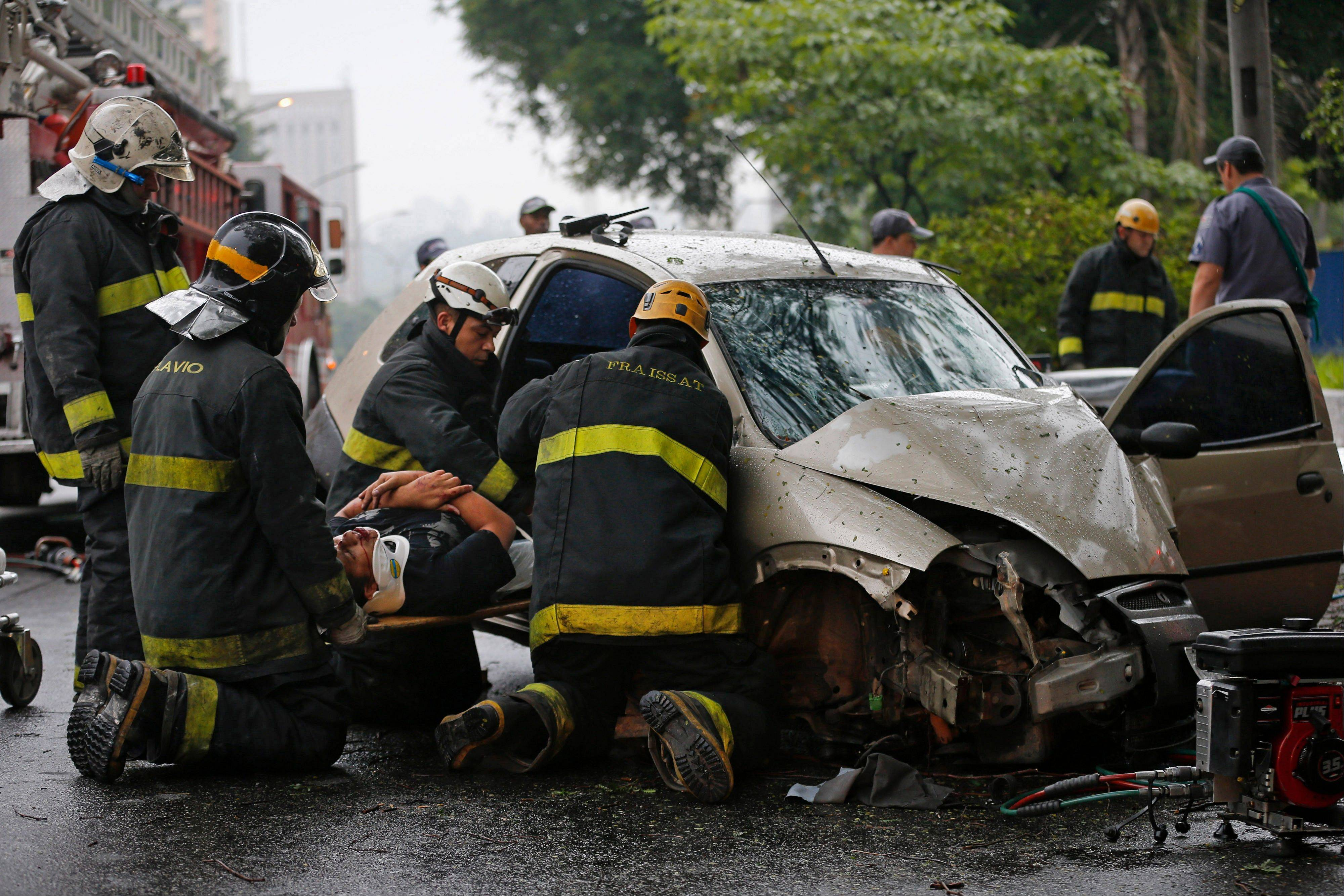 Associated Press/Nov. 25, 2012 Firefighters rescue a man from a car crash in Sao Paulo, Brazil. Three men were injured when they lost control of their Ford Ka car on one of Sao Paulo main avenues during a rainy morning.