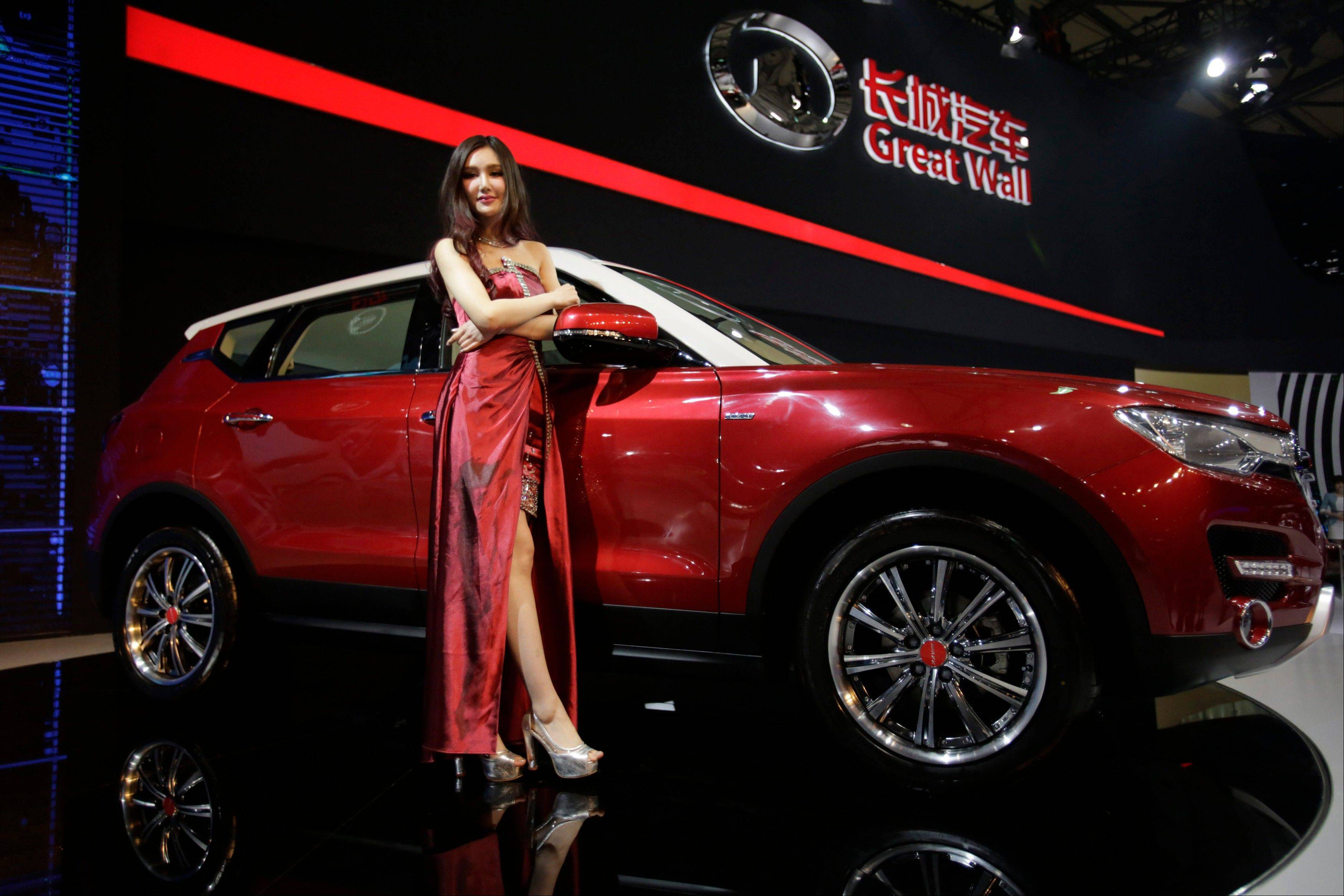 A model poses with a Great Wall H7 SUV at the Shanghai International Automobile Industry Exhibition (AUTO Shanghai) media day in Shanghai, China. SUV sales in China rose 20 percent last year to 2.5 million vehicles, more than double the 8 percent growth of the overall auto market, according to LMC Automotive. SUVs made up 18 percent of all vehicles sold. Great Wall Motor Co., has become the Chinese industry's breakout success on the strength of its SUVs. The company, headquartered in Baoding, an industrial city southwest of Beijing, said SUV sales in the first three months of the year rose 95 percent over a year earlier and accounted for half the 180,000 vehicles it sold.