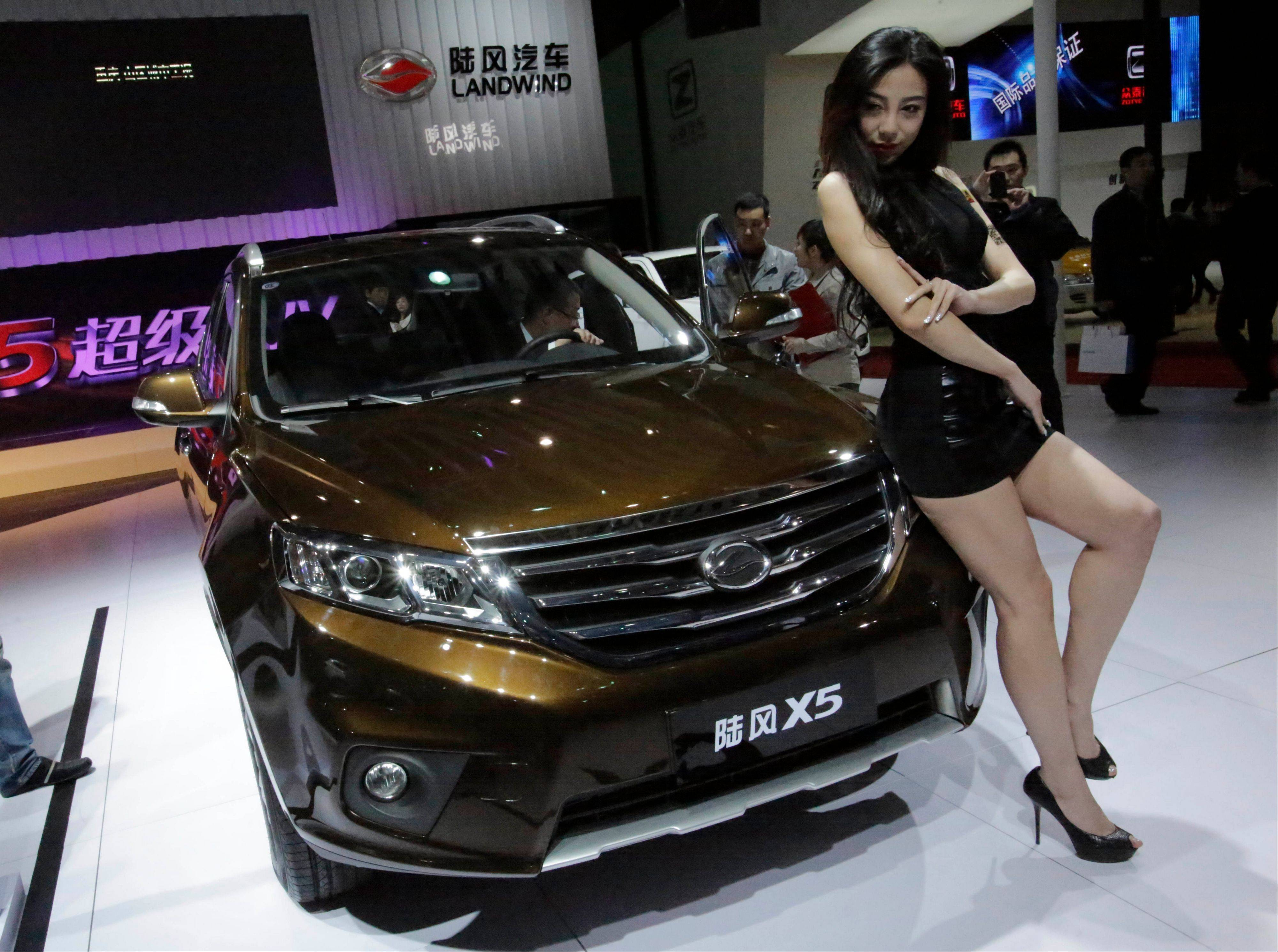 A model poses with the new Landwind X5 SUV at the Shanghai International Automobile Industry Exhibition (AUTO Shanghai) media day in Shanghai, China. SUV sales in China rose 20 percent last year to 2.5 million vehicles, more than double the 8 percent growth of the overall auto market, according to LMC Automotive. SUVs made up 18 percent of all vehicles sold.
