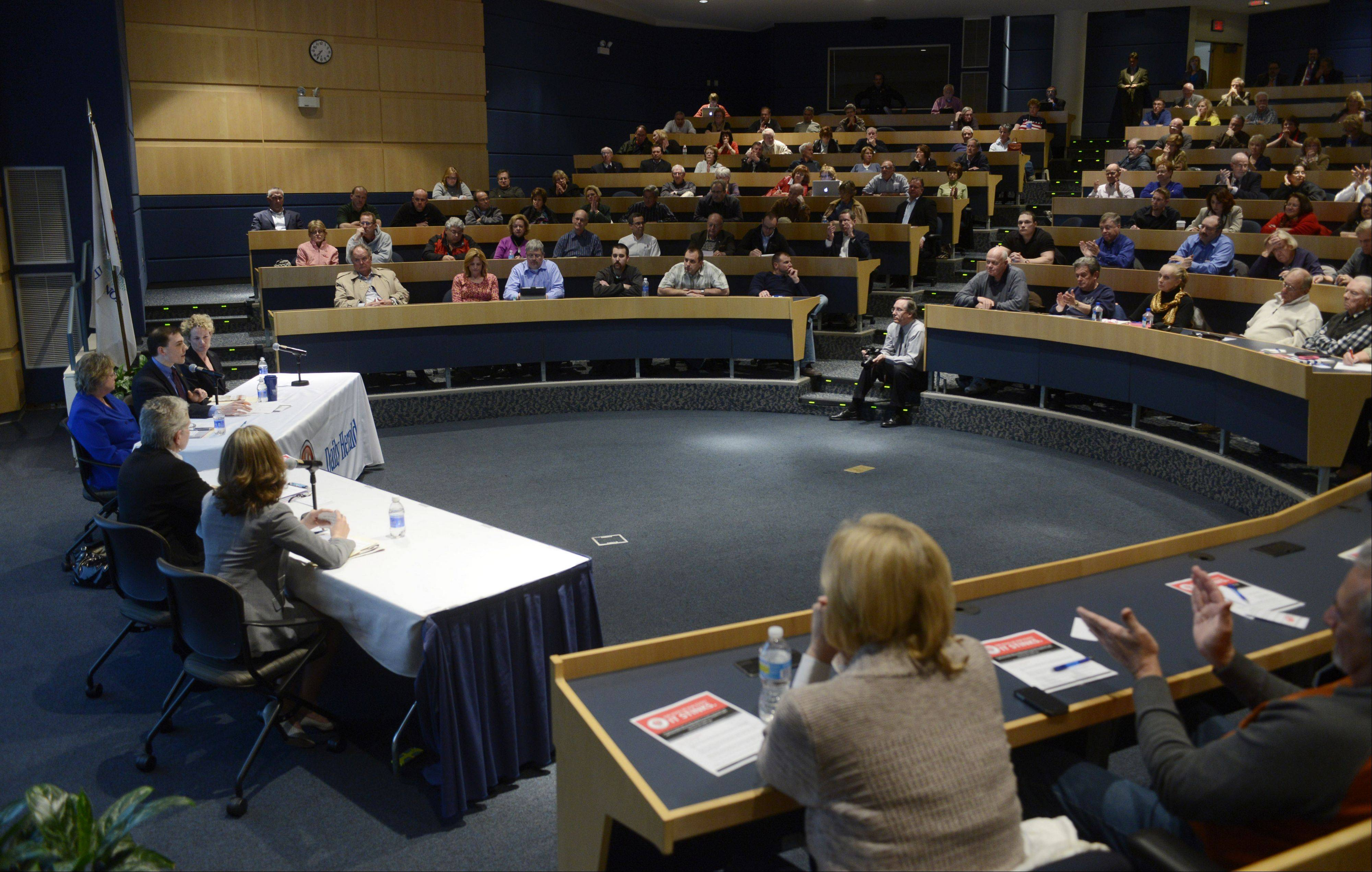 JOE LEWNARD/jlewnard@dailyherald.com � A packed house participated in a pension reform forum sponsored by the Daily Herald and Reboot Illinois at Harper College in Palatine last month.
