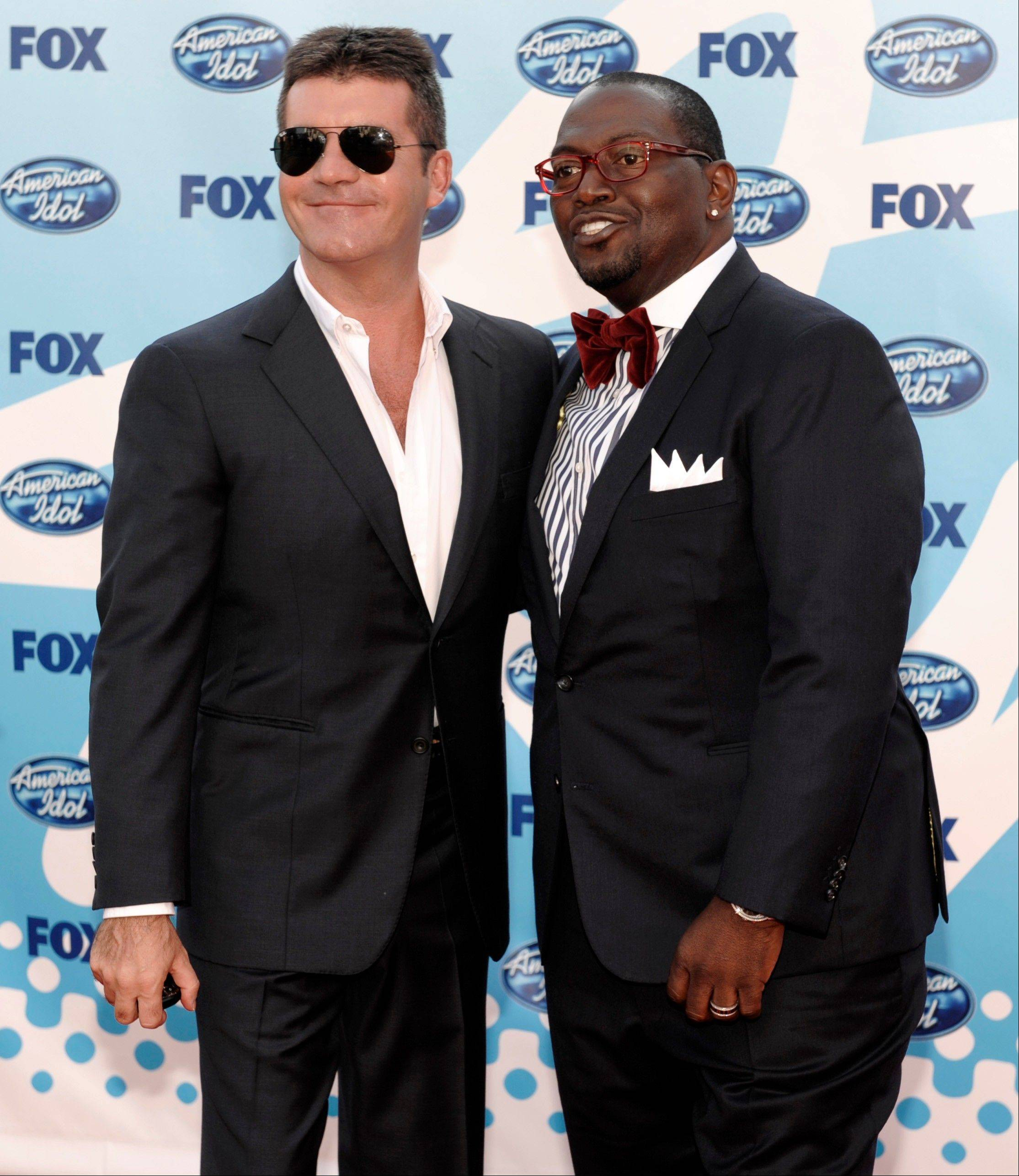 "In this May 20, 2009 file photo, Judges Simon Cowell, left, and Randy Jackson arrive at the ""American Idol"" finale in Los Angeles. Jackson's announcement on Thursday that he was departing the show means producers could plan a proper send-off for the lone remaining original judge soon, much the same way they did for Simon Cowell during the ninth season finale in 2010."