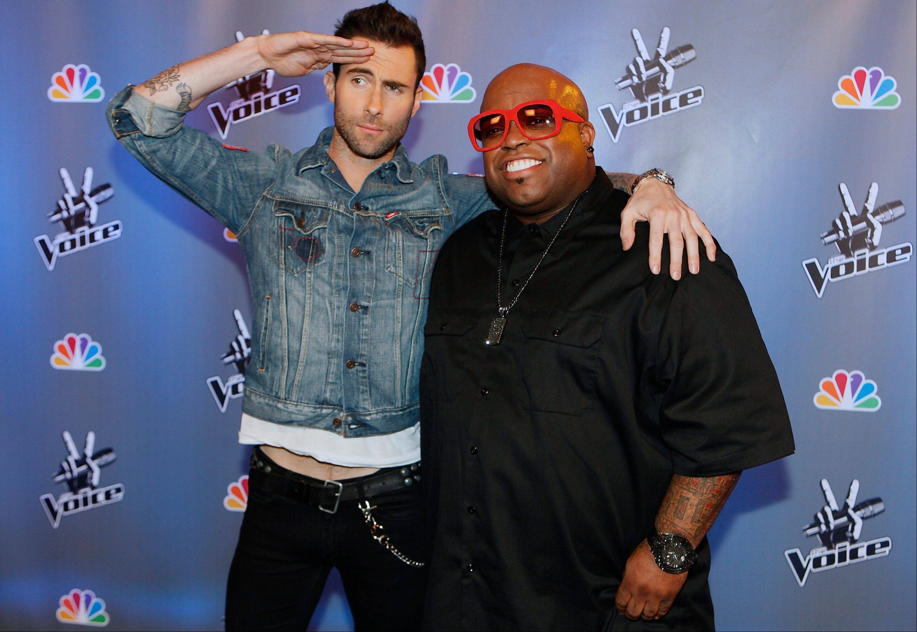 "In this March 15, 2011 file photo, singers Adam Levine, left, and Cee Lo Green, pose at the set of ""The Voice, "" television series at Los Angeles Center Studios, in Los Angeles. It's likely no consolation that over on NBC's ""The Voice,"" which has regularly toppled ""Idol"" in the ratings this year, drama-free celebrity panelists like Usher, Adam Levine, Cee Lo Green and Shakira actually seem to all get along."