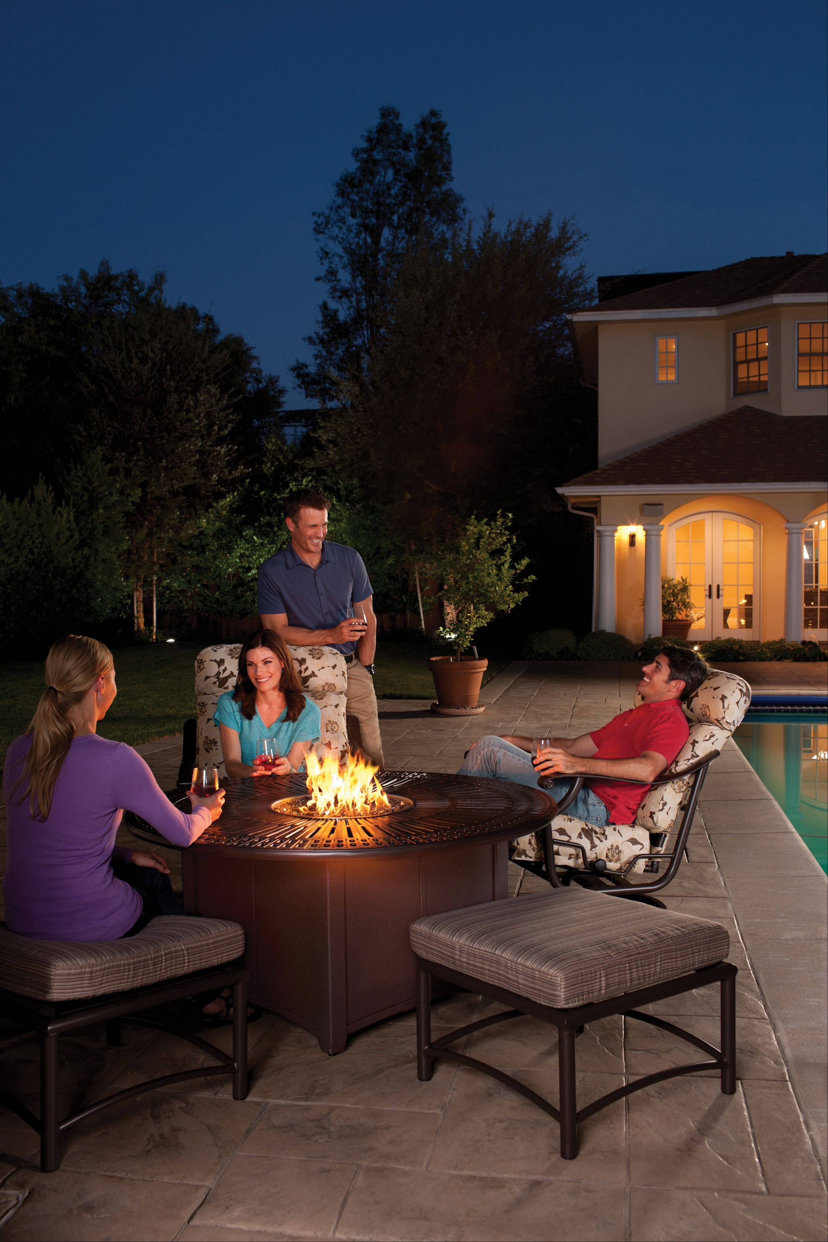Fire pits in the middle of tables, such as this one by Tropitone, available through Hearth and Home, allow homeowners to make the best use of their outdoor space. Some models even have cooking attachments that allow for fondue and other treats.