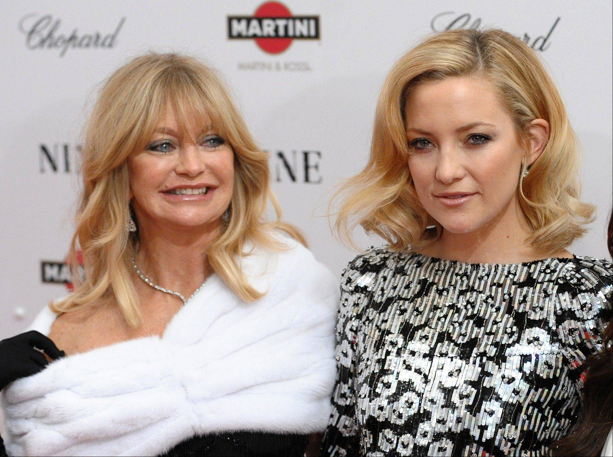 "Actress Goldie Hawn, left, and her daughter Kate Hudson at the premiere of ""Nine"" at the Ziegfeld Theatre in New York. The mother-daughter pair has never acted together, but they teamed up for an Almay ad for Mother's Day."