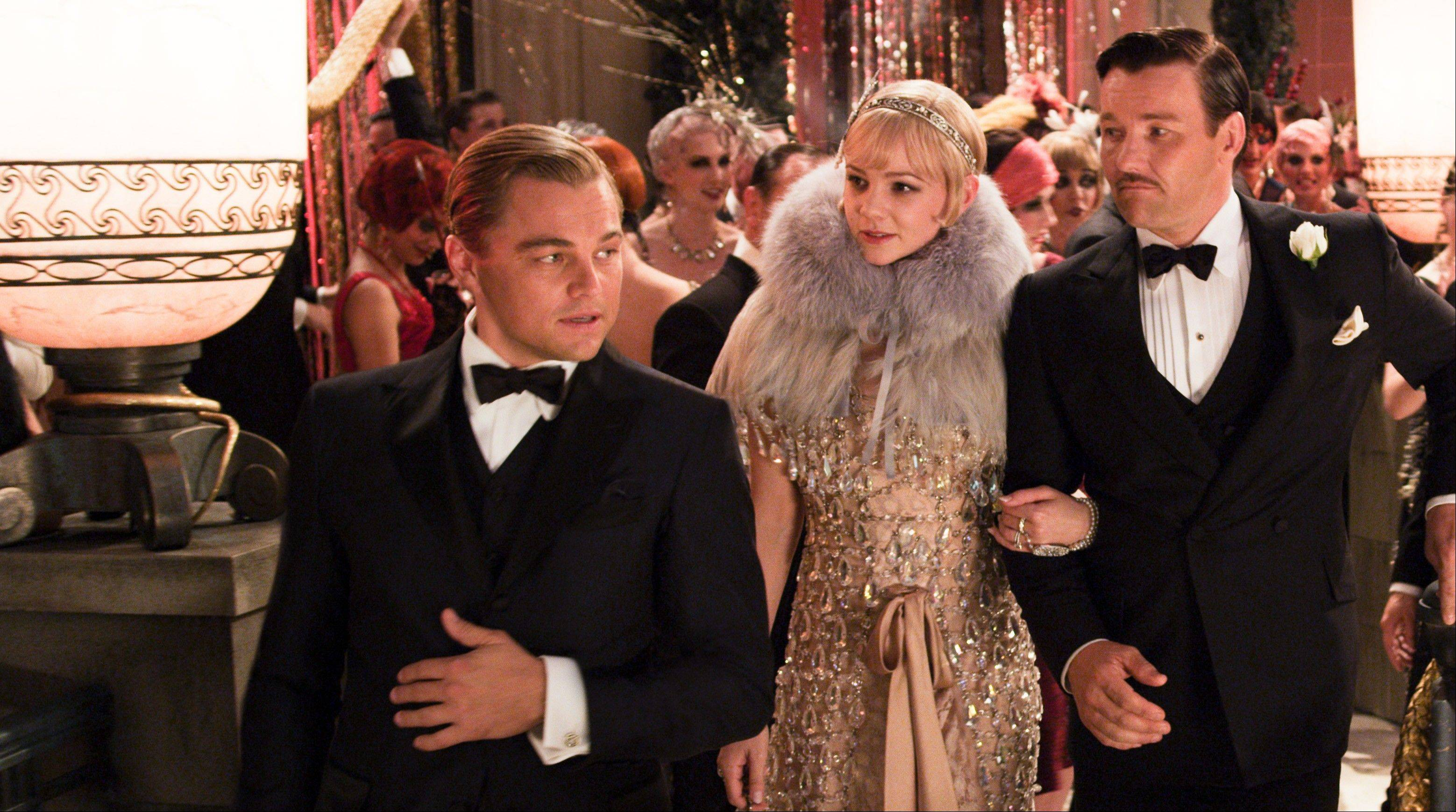 "Leonardo DiCaprio, left, as Jay Gatsby, Carey Mulligan, as Daisy Buchanan and Joel Edgerton as Tom Buchanan in ""The Great Gatsby."""