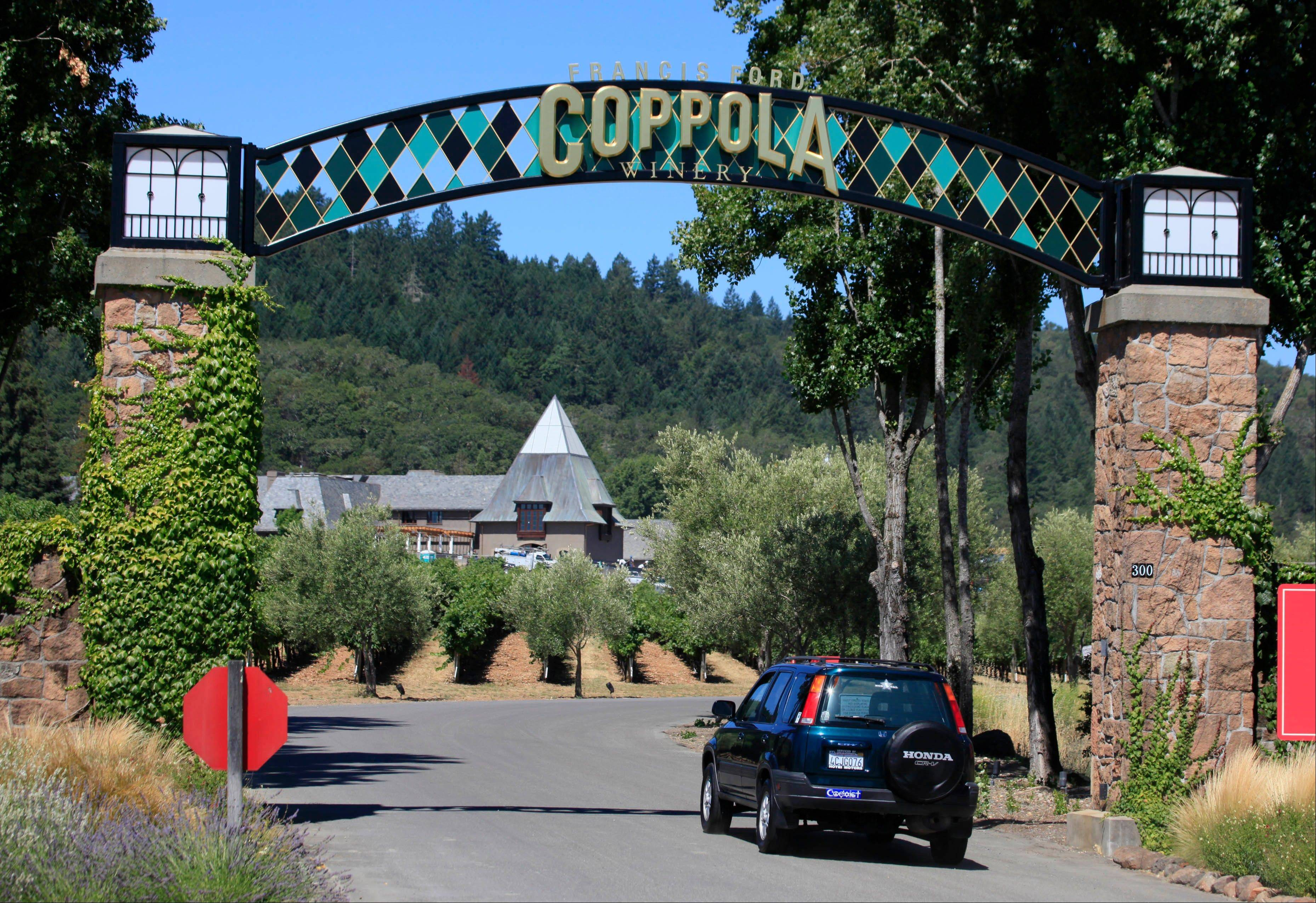 A car enters the Francis Ford Coppola Winery in Geyserville, Calif. Part resort, part winery, this property in Sonoma County has a lot of extras including a swimming pool, cabines equipped with showers for rent, bocce courts and two places to eat.