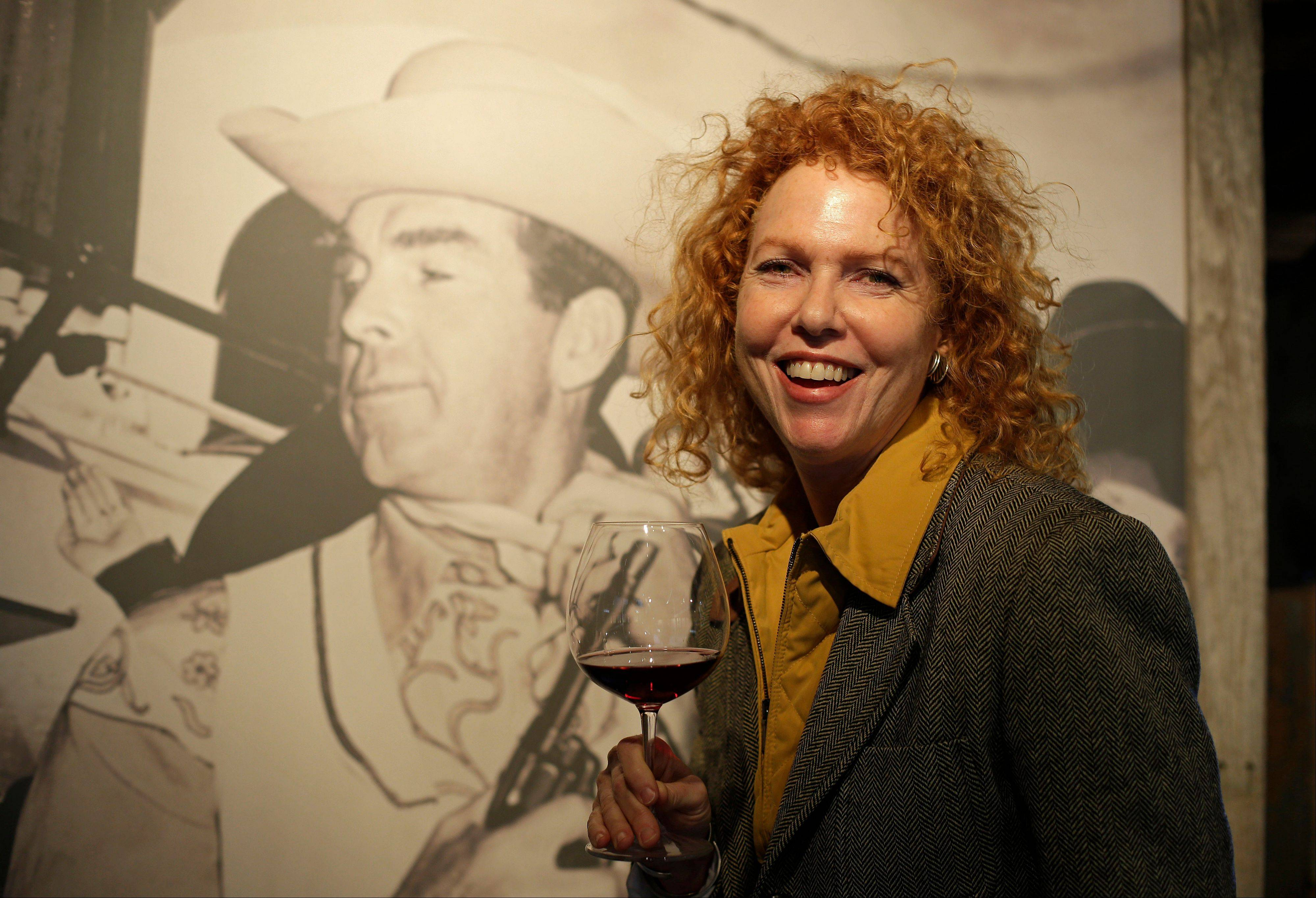Kate MacMurray, daughter of the late actor Fred MacMurray, in a tasting area and gallery of old photographs at the MacMurray Ranch in Healdsburg, Calif. The former cattle ranch now produces wine and is owned by the Gallo wine family.