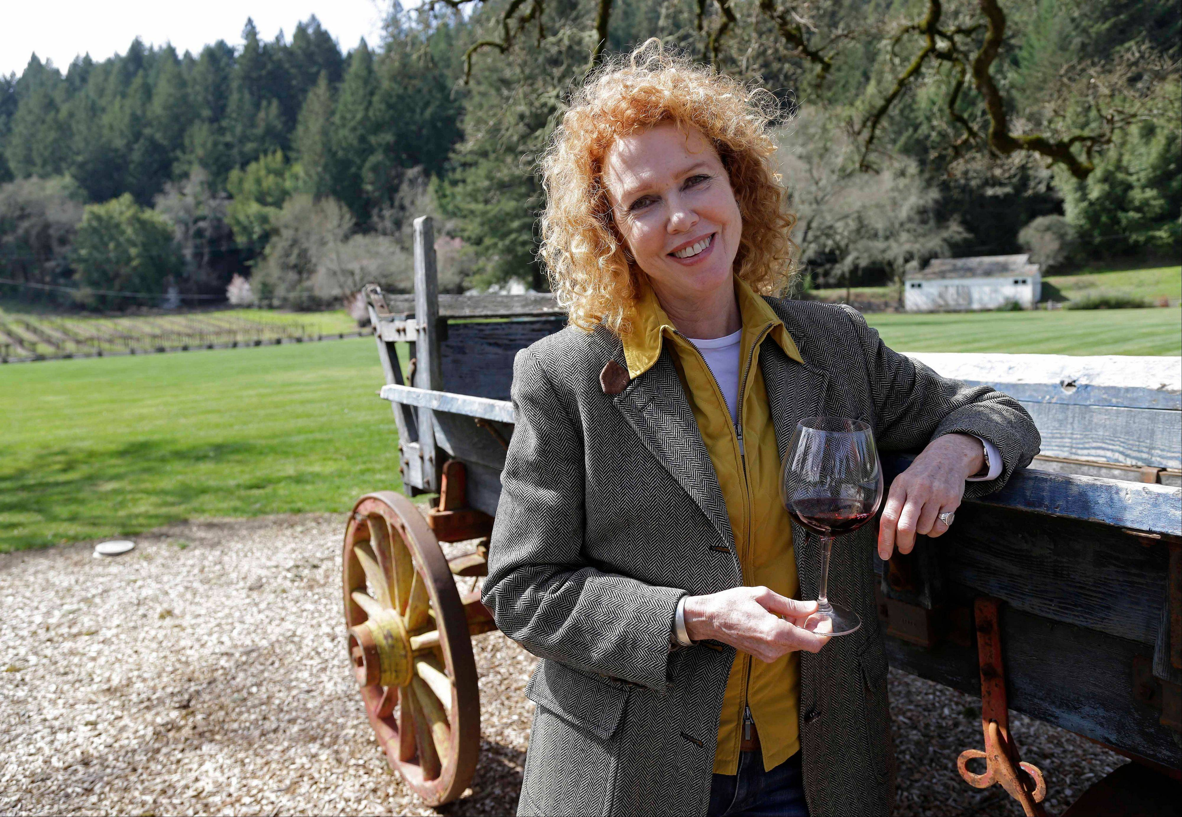 Kate MacMurray, daughter of the late actor Fred MacMurray with an old wooden wagon used for diversified farming in World War II and then for cattle at the MacMurray Ranch in Healdsburg, Calif.