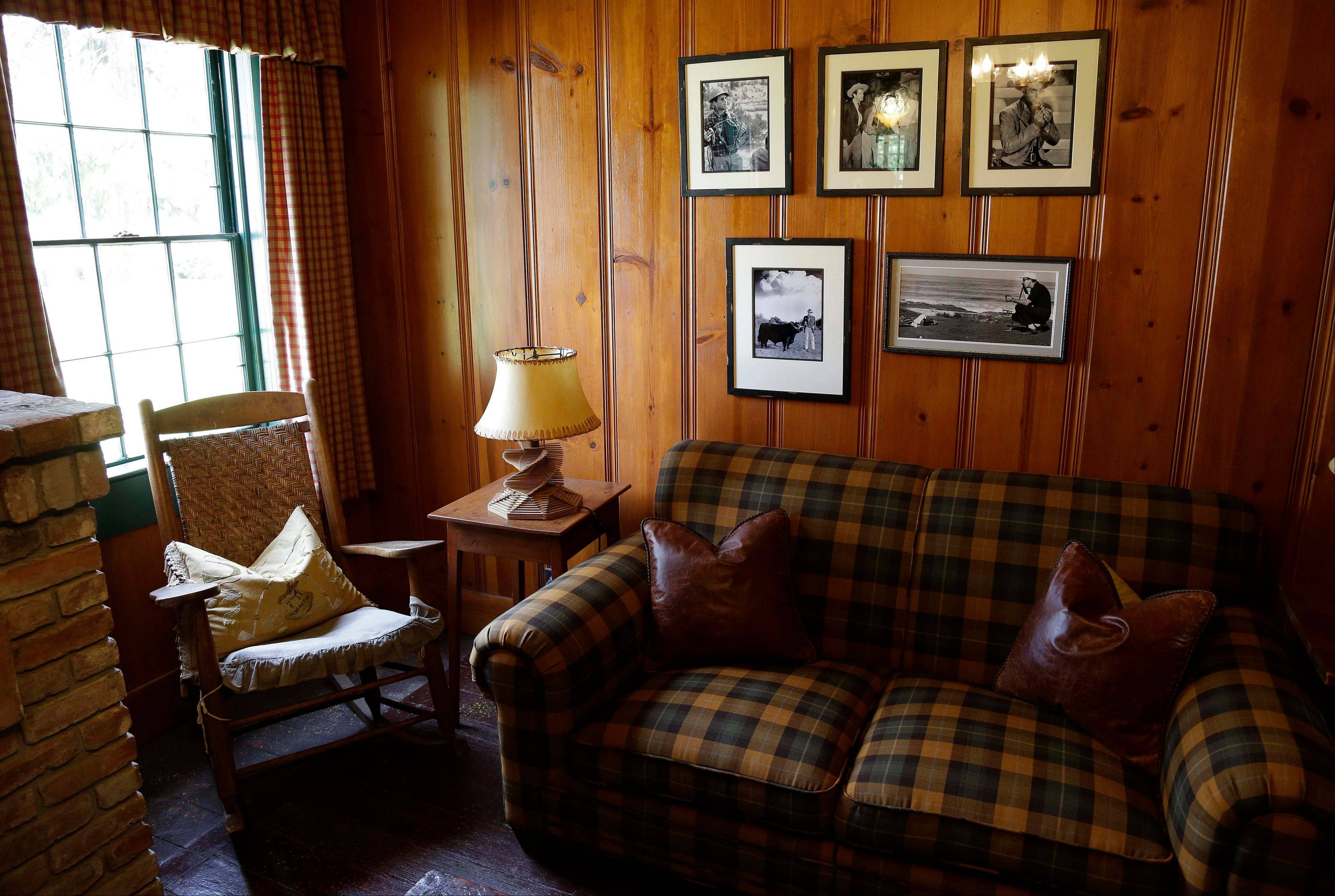 A selection of old photographs hang in a study beside actor Fred MacMurray's rocking chair at the MacMurray Ranch.