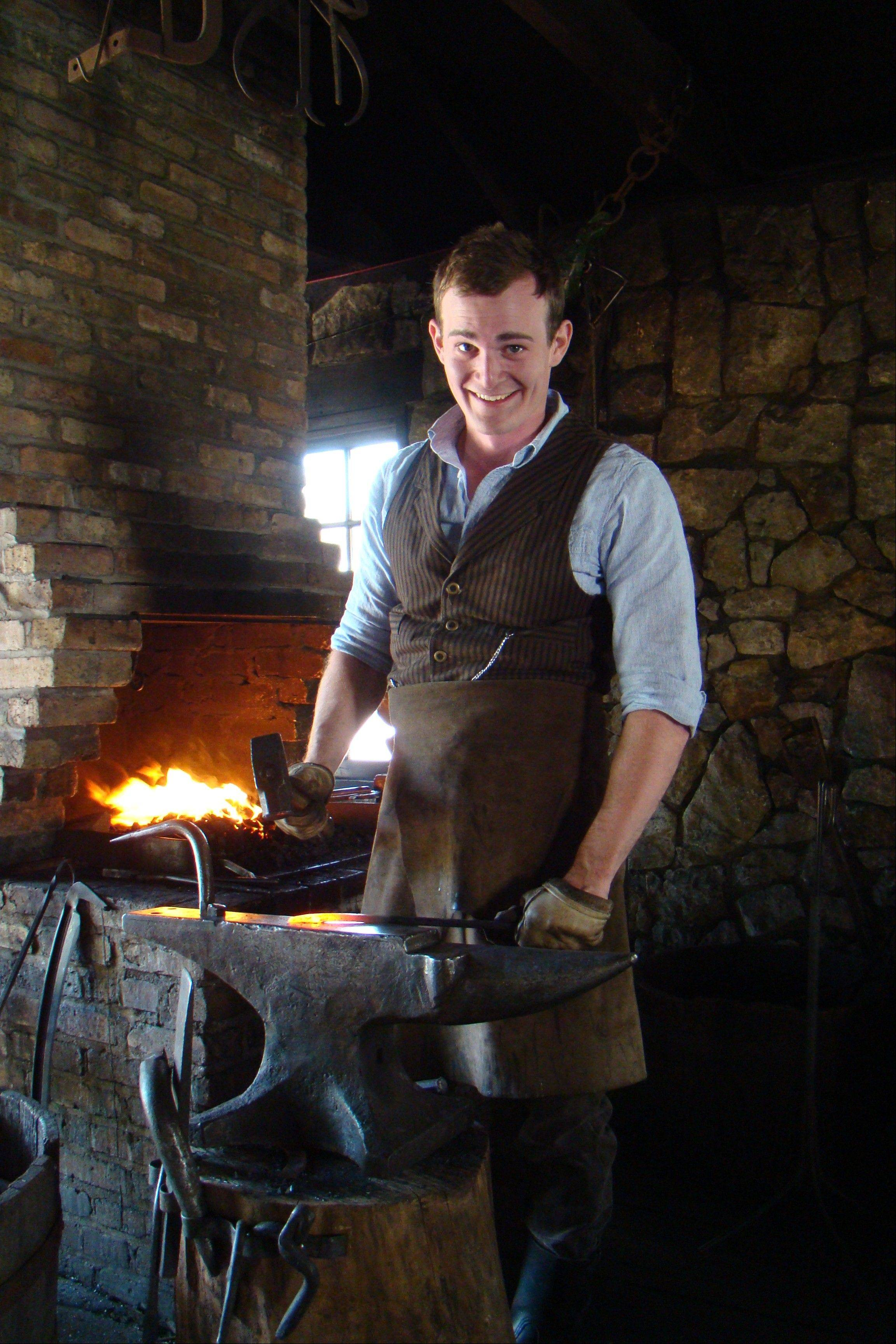 Museum educator Justin Stech demonstrates the art of blacksmithing at Naper Settlement in Naperville.