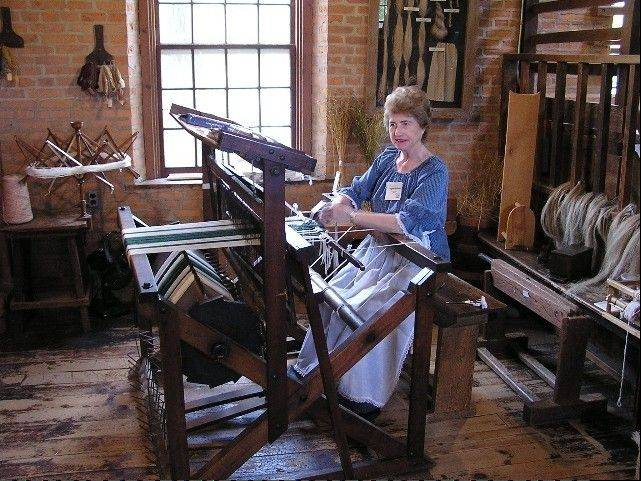 Volunteer and museum board member Virginia Reisner demonstrates weaving on Graue Mill's 100-year-old weaving loom. The rugs, towels and placements that weavers create on this loom are sold in the museum's gift shop.
